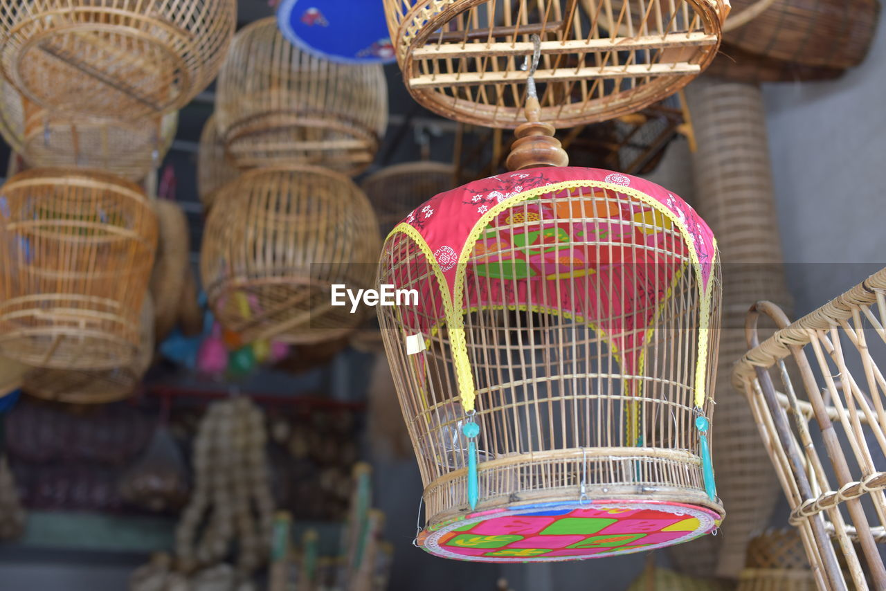 for sale, market, basket, focus on foreground, day, container, no people, art and craft, close-up, retail, multi colored, market stall, craft, wicker, birdcage, cage, creativity, large group of objects, business, selective focus, sale, retail display