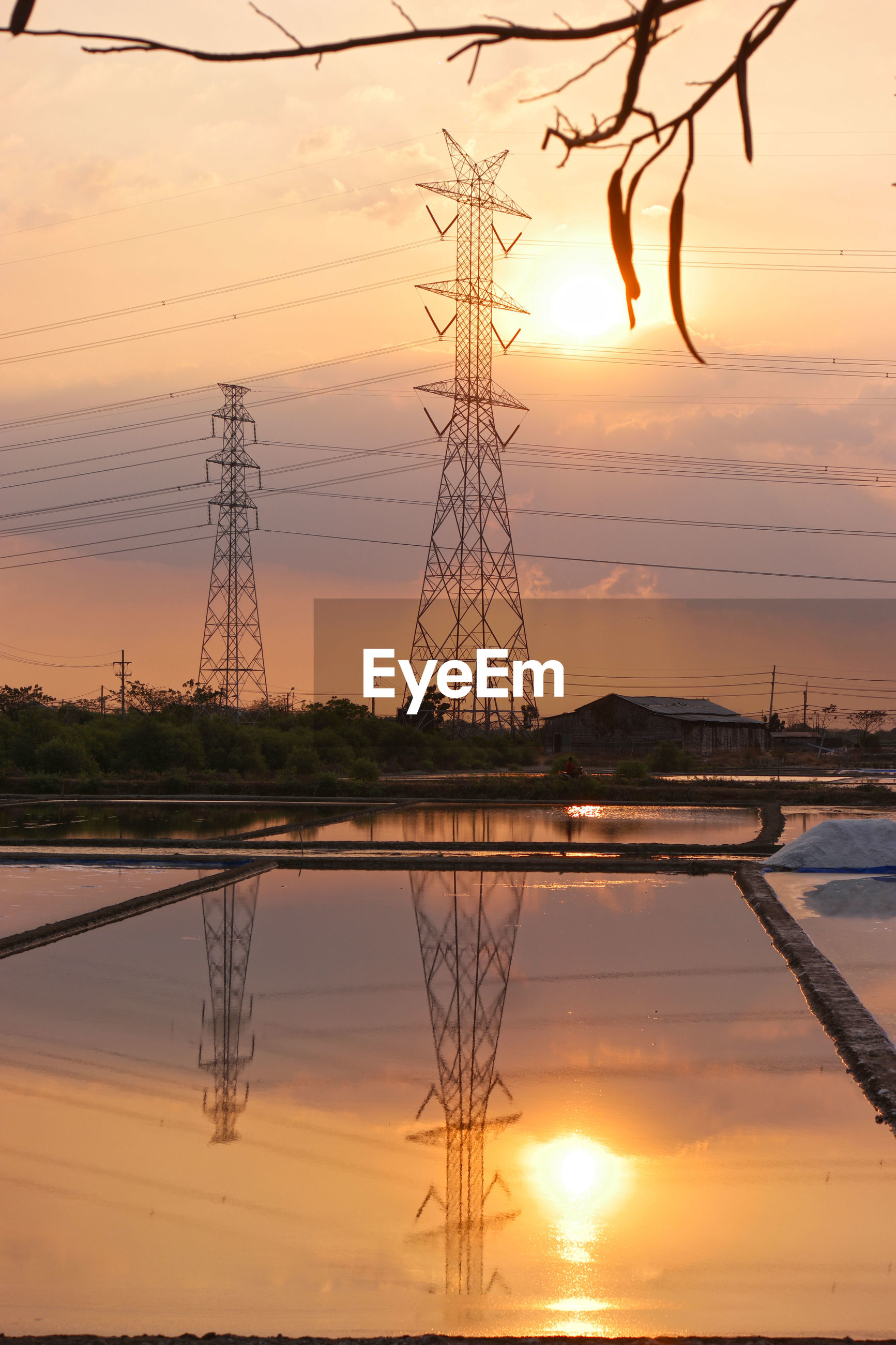 Electricity pylon against sky during sunset