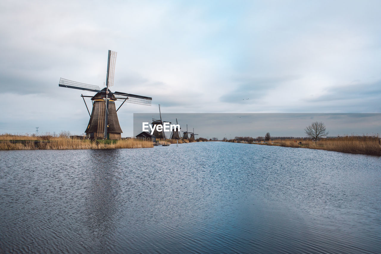 TRADITIONAL WINDMILLS AGAINST SKY