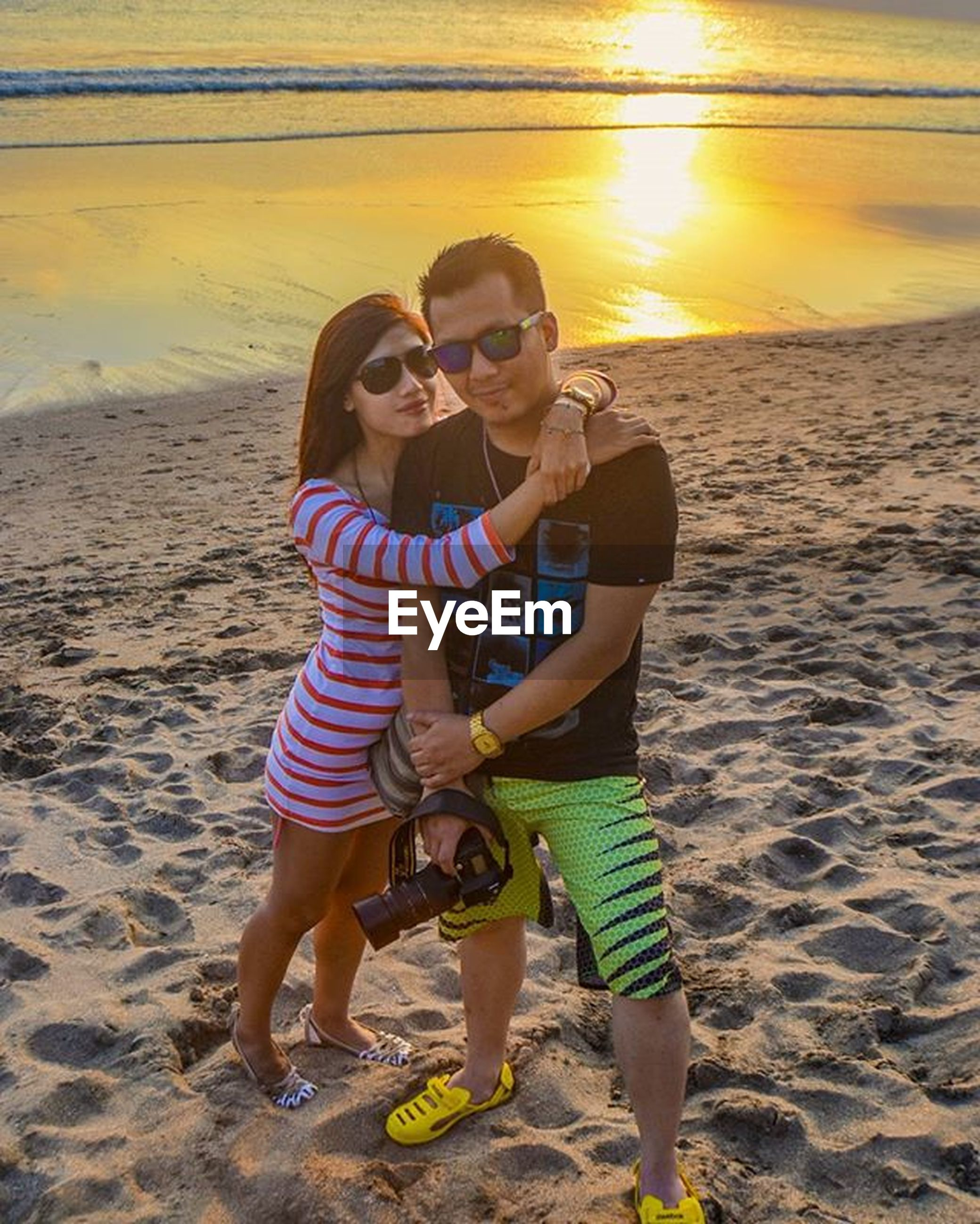 lifestyles, childhood, full length, leisure activity, togetherness, casual clothing, boys, bonding, person, beach, girls, elementary age, love, sand, family, happiness, sunlight, enjoyment