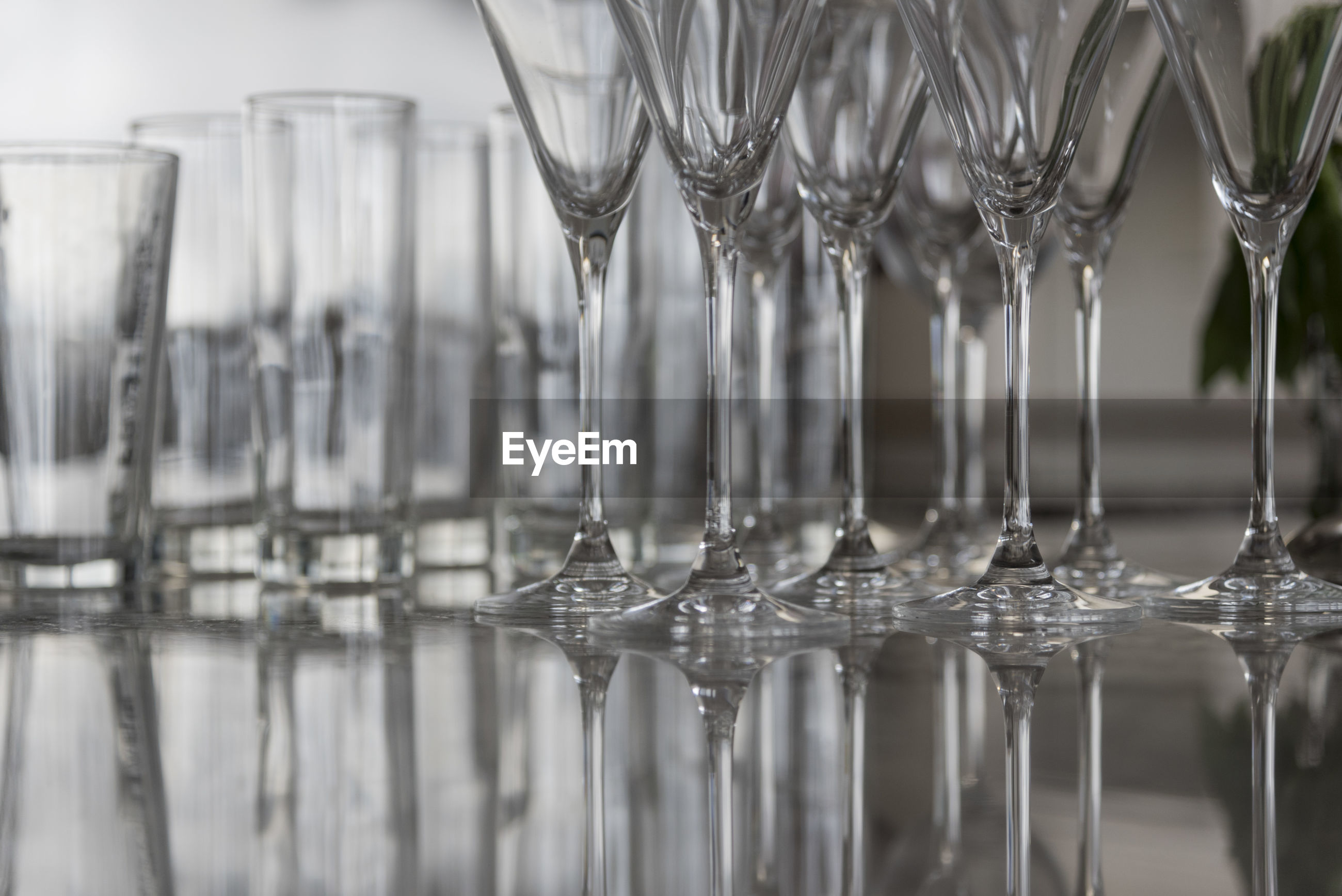 Close-up of empty drinking glasses on table at restaurant