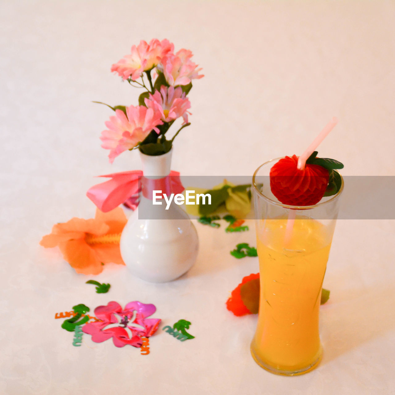 Close-up of cocktail glass with flower decoration on table