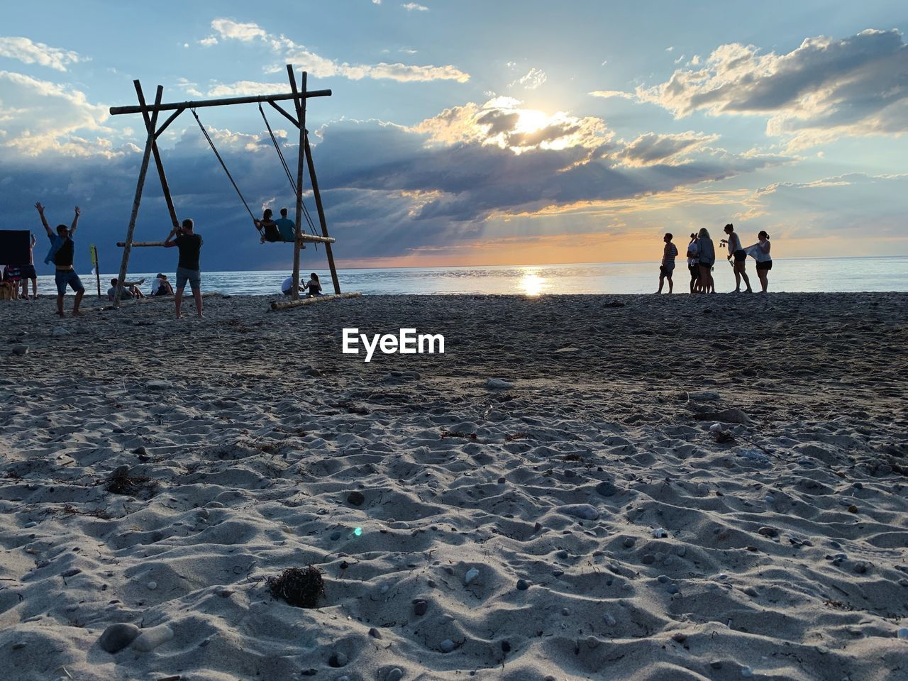 sky, beach, land, group of people, sea, water, sunset, real people, cloud - sky, beauty in nature, men, scenics - nature, nature, leisure activity, lifestyles, horizon, horizon over water, sand, people
