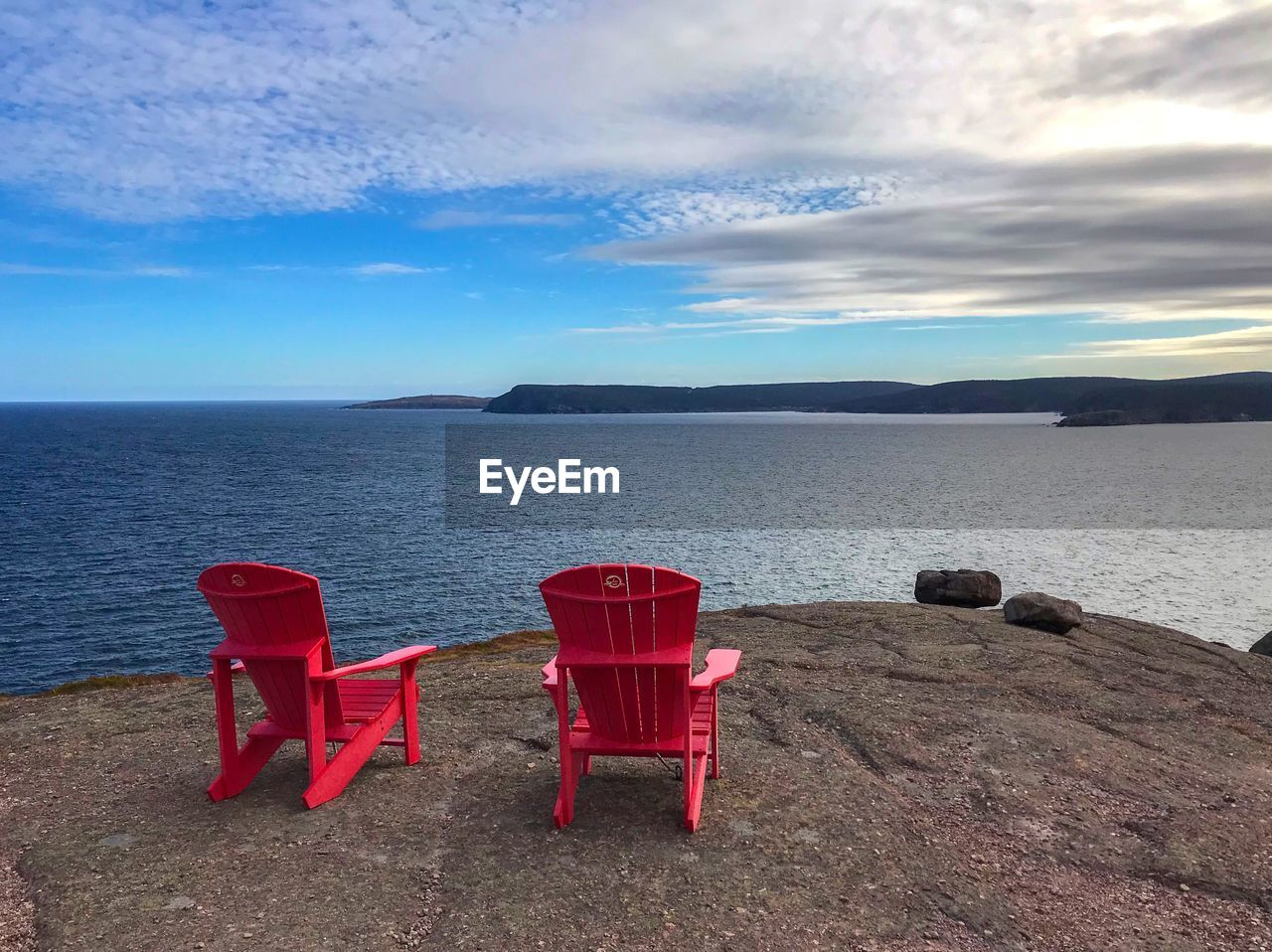 water, sea, sky, beauty in nature, scenics - nature, tranquil scene, cloud - sky, red, tranquility, horizon over water, seat, horizon, no people, beach, chair, nature, land, idyllic, absence, outdoors