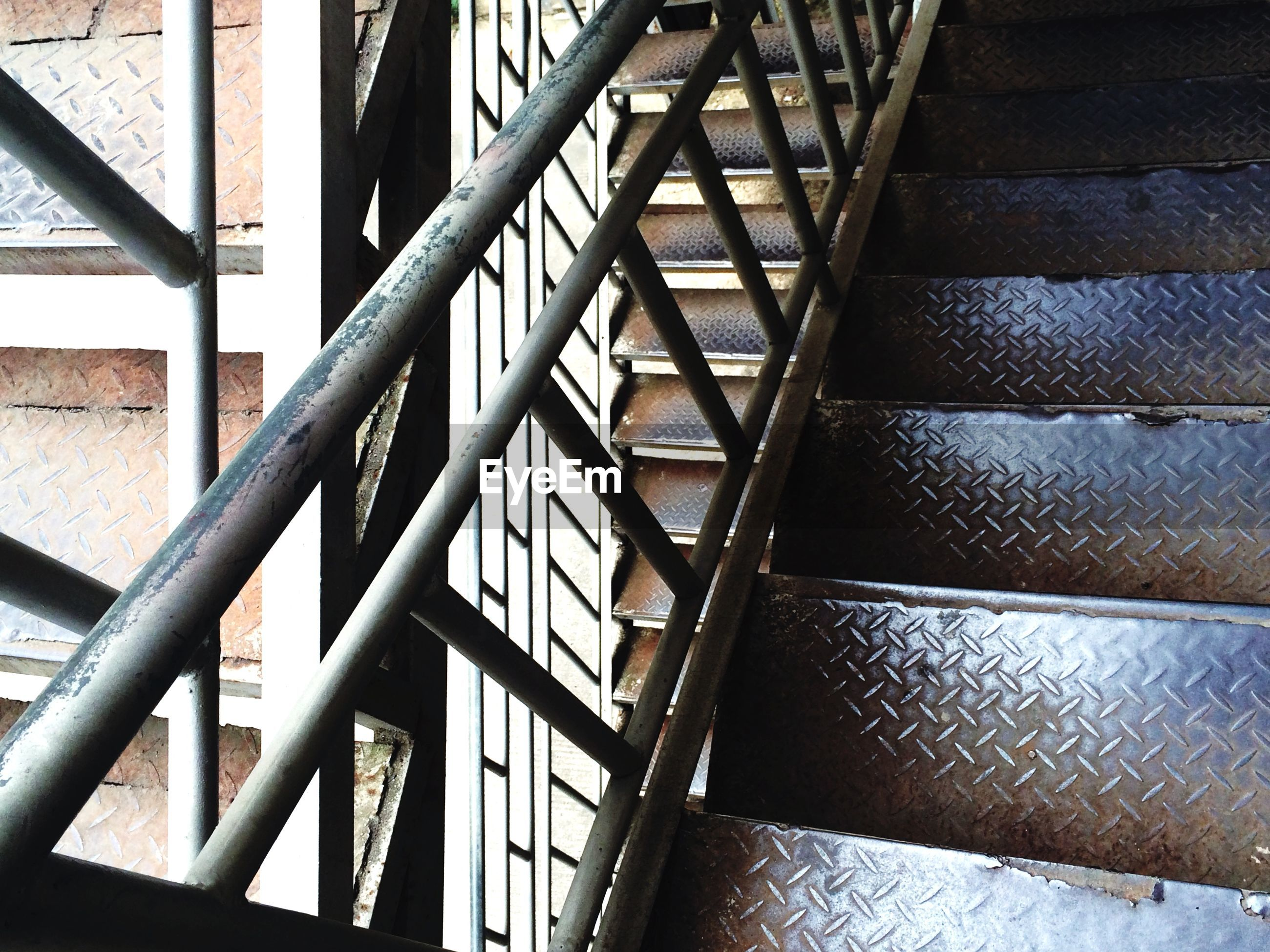 architecture, built structure, pattern, indoors, metal, full frame, low angle view, design, railing, metallic, backgrounds, diminishing perspective, repetition, steps and staircases, architectural feature, steps, building exterior, grid, no people, staircase