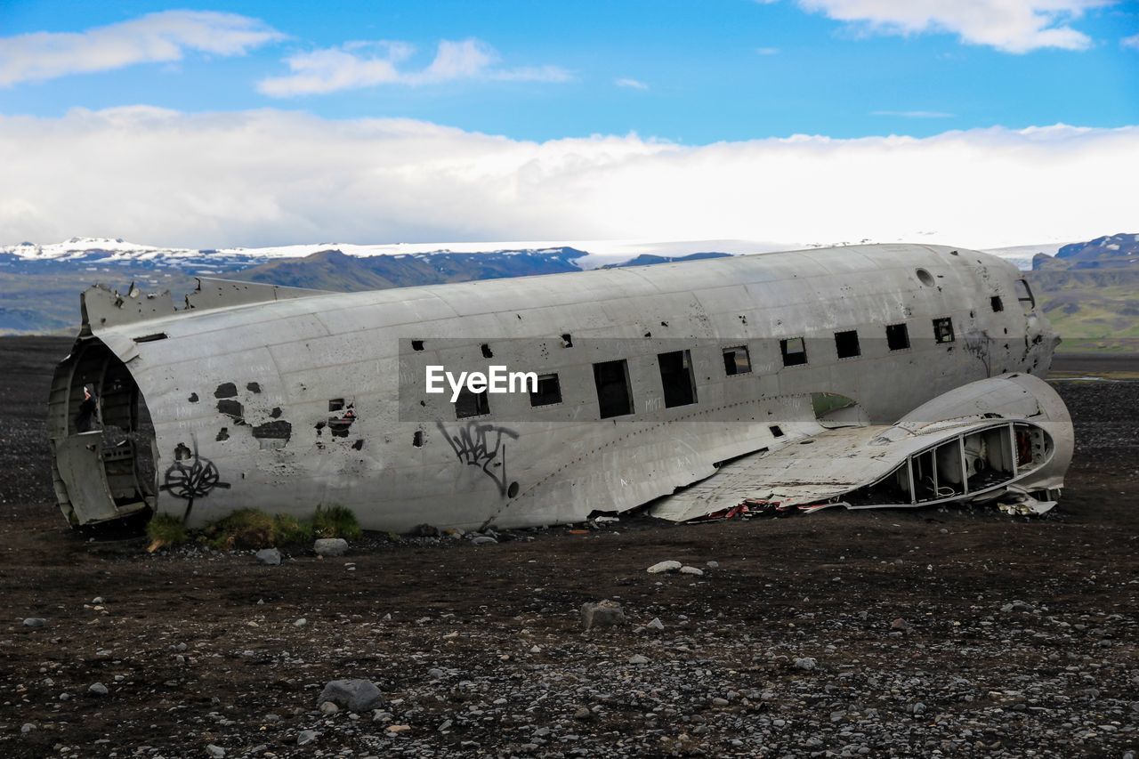 abandoned, sky, air vehicle, airplane, cloud - sky, transportation, damaged, obsolete, mode of transportation, land, history, nature, day, run-down, the past, deterioration, old, travel, decline, architecture, no people, outdoors, aerospace industry, ruined, demolished, navy