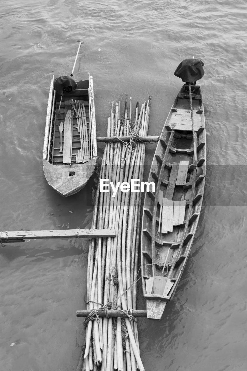 water, nautical vessel, mode of transportation, no people, transportation, high angle view, day, sea, nature, moored, bird, outdoors, built structure, architecture, waterfront, travel, vertebrate, animal themes, animal, rowboat, wooden post