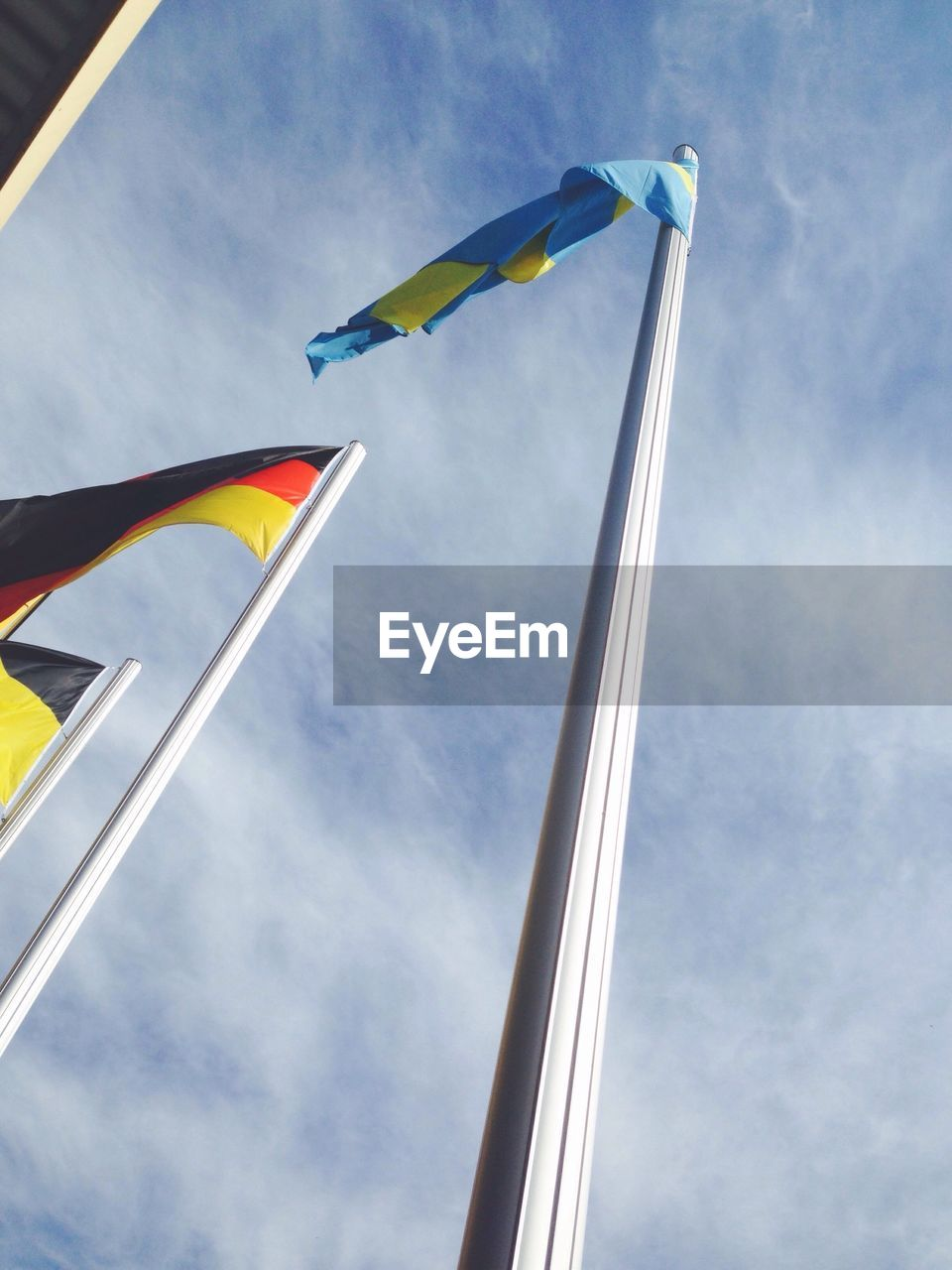 flag, patriotism, pride, wind, waving, low angle view, national icon, day, sky, outdoors, no people