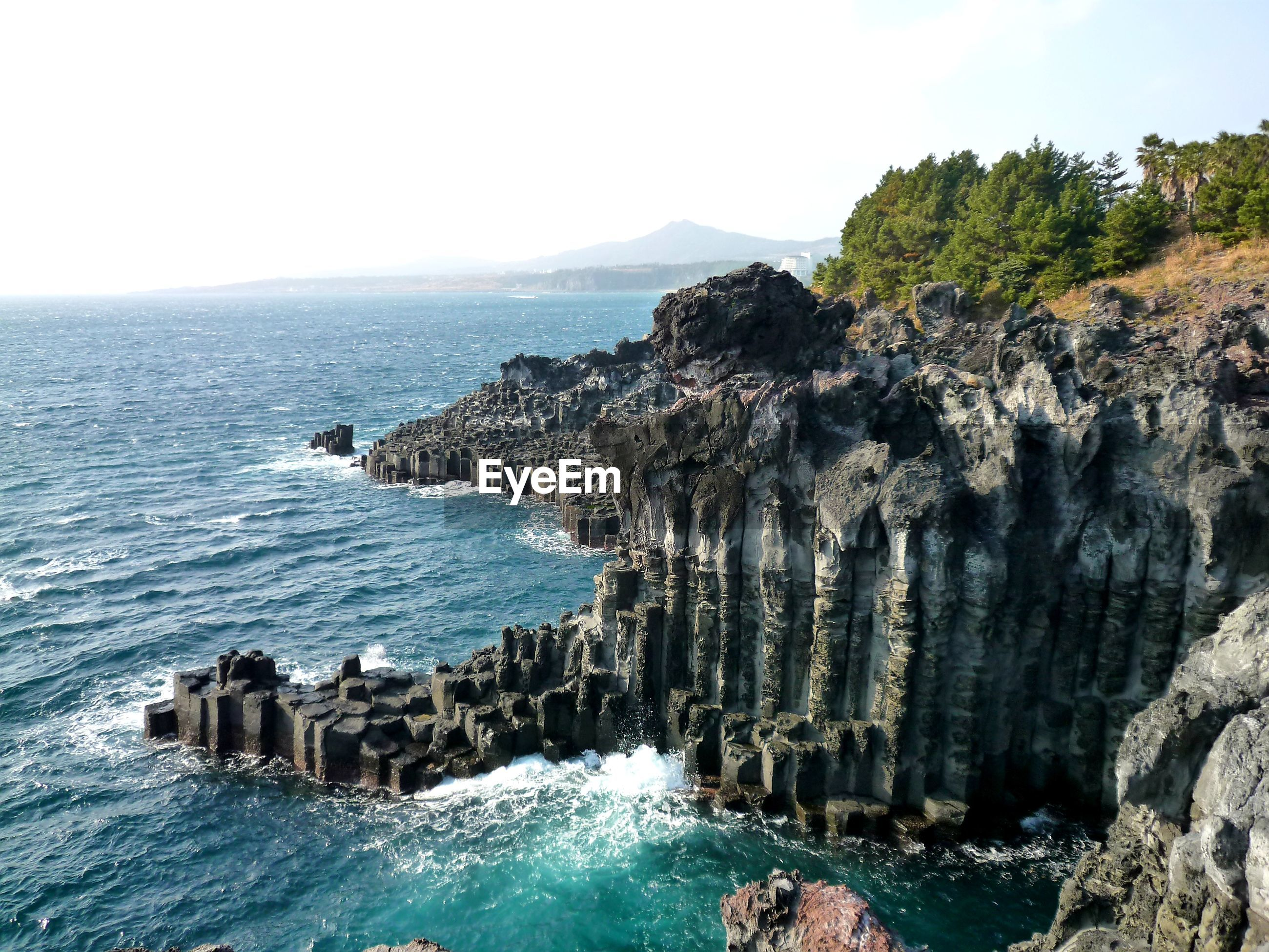 PANORAMIC VIEW OF SEA AND ROCK FORMATION AGAINST SKY
