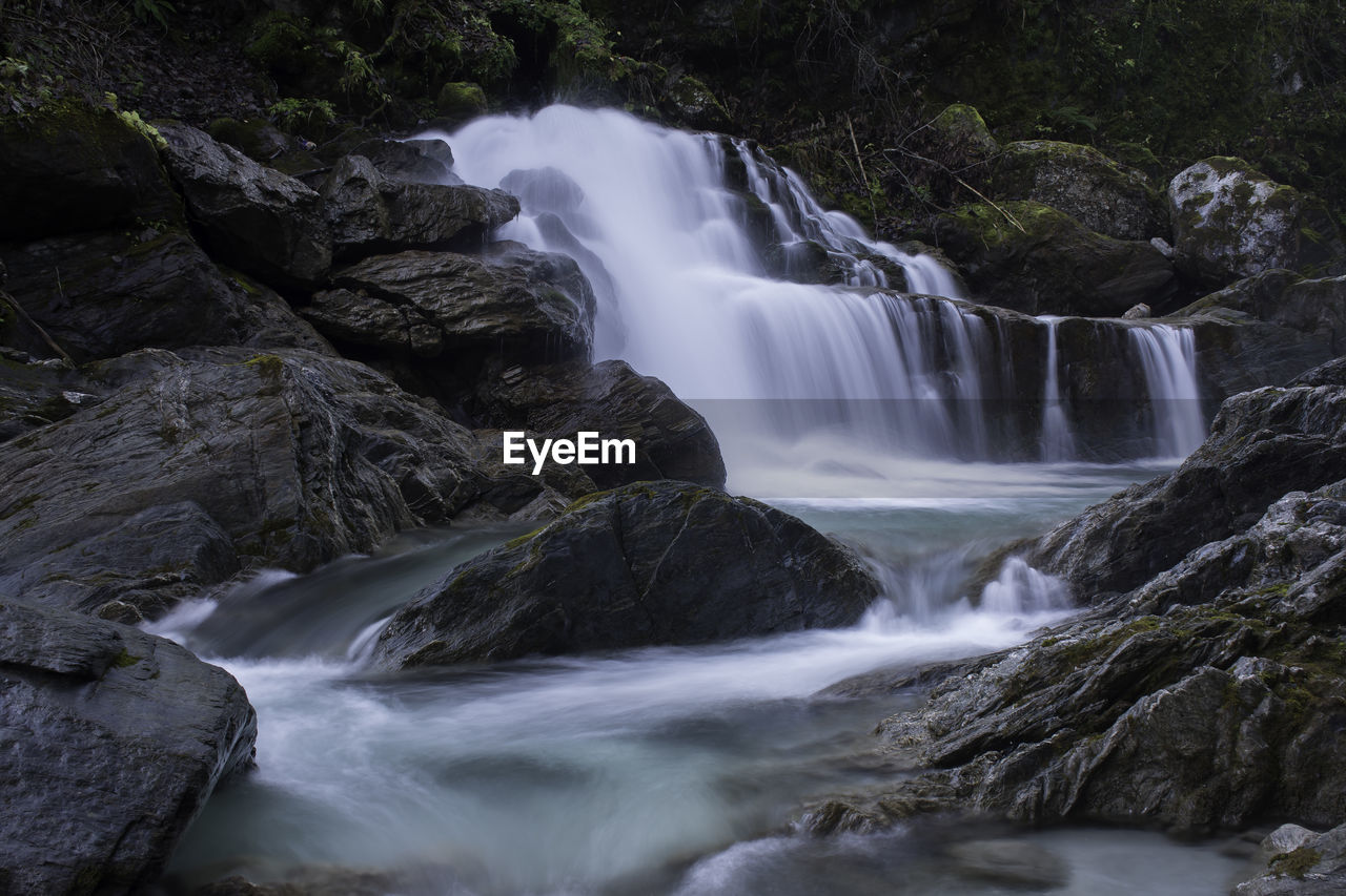 long exposure, scenics - nature, waterfall, flowing water, water, motion, blurred motion, rock, beauty in nature, solid, rock - object, tree, forest, flowing, no people, rock formation, environment, nature, land, outdoors, power in nature, rainforest