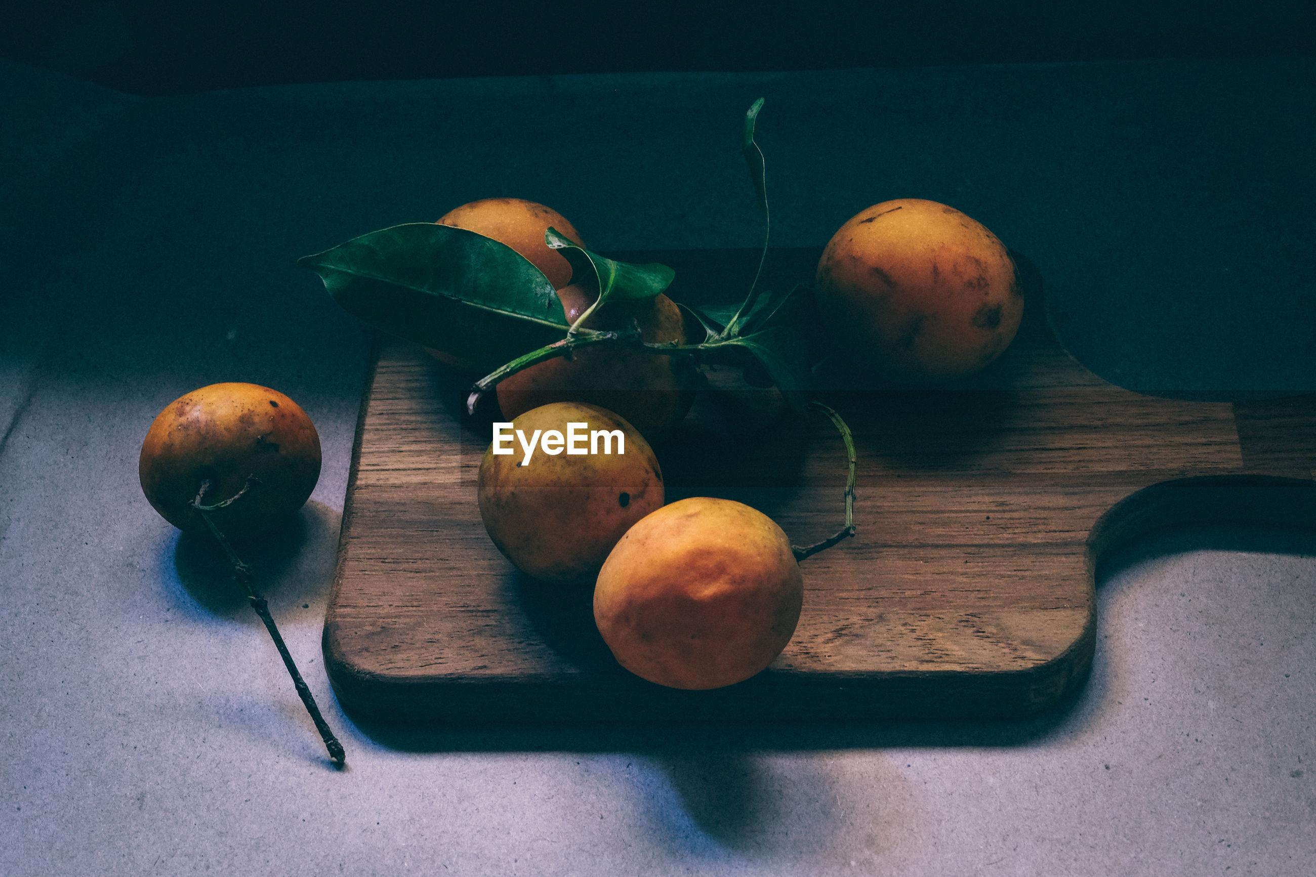 High angle view of lemons on cutting board