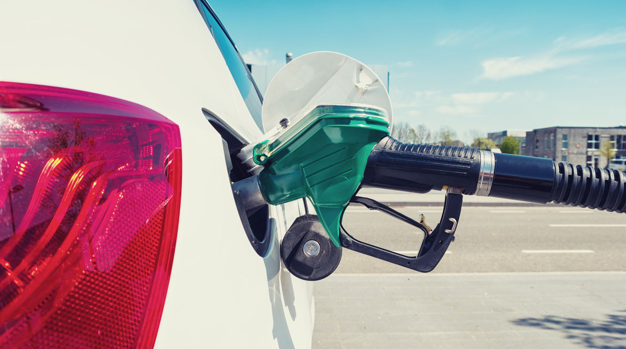 Close-Up Of Fuel Pump Refueling Car At Gas Station
