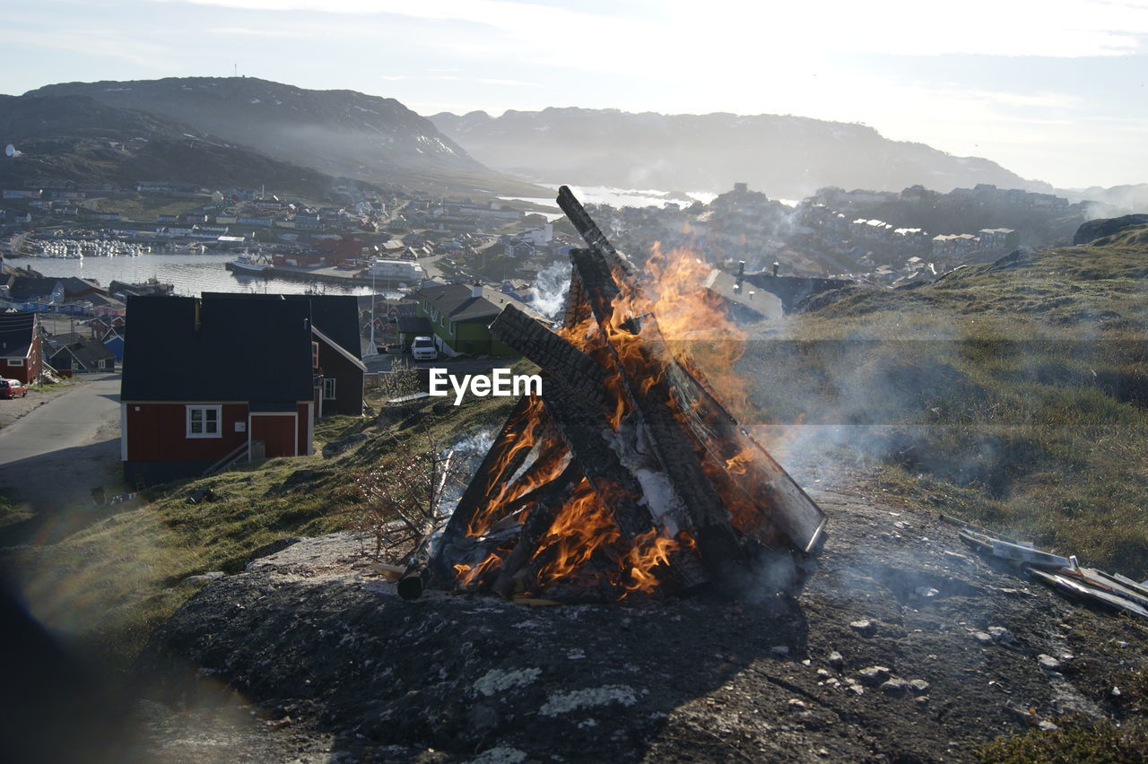 mountain, nature, heat - temperature, environment, flame, sky, burning, fire, fire - natural phenomenon, mountain range, wood, smoke - physical structure, day, land, landscape, no people, wood - material, built structure, architecture, scenics - nature, outdoors, bonfire
