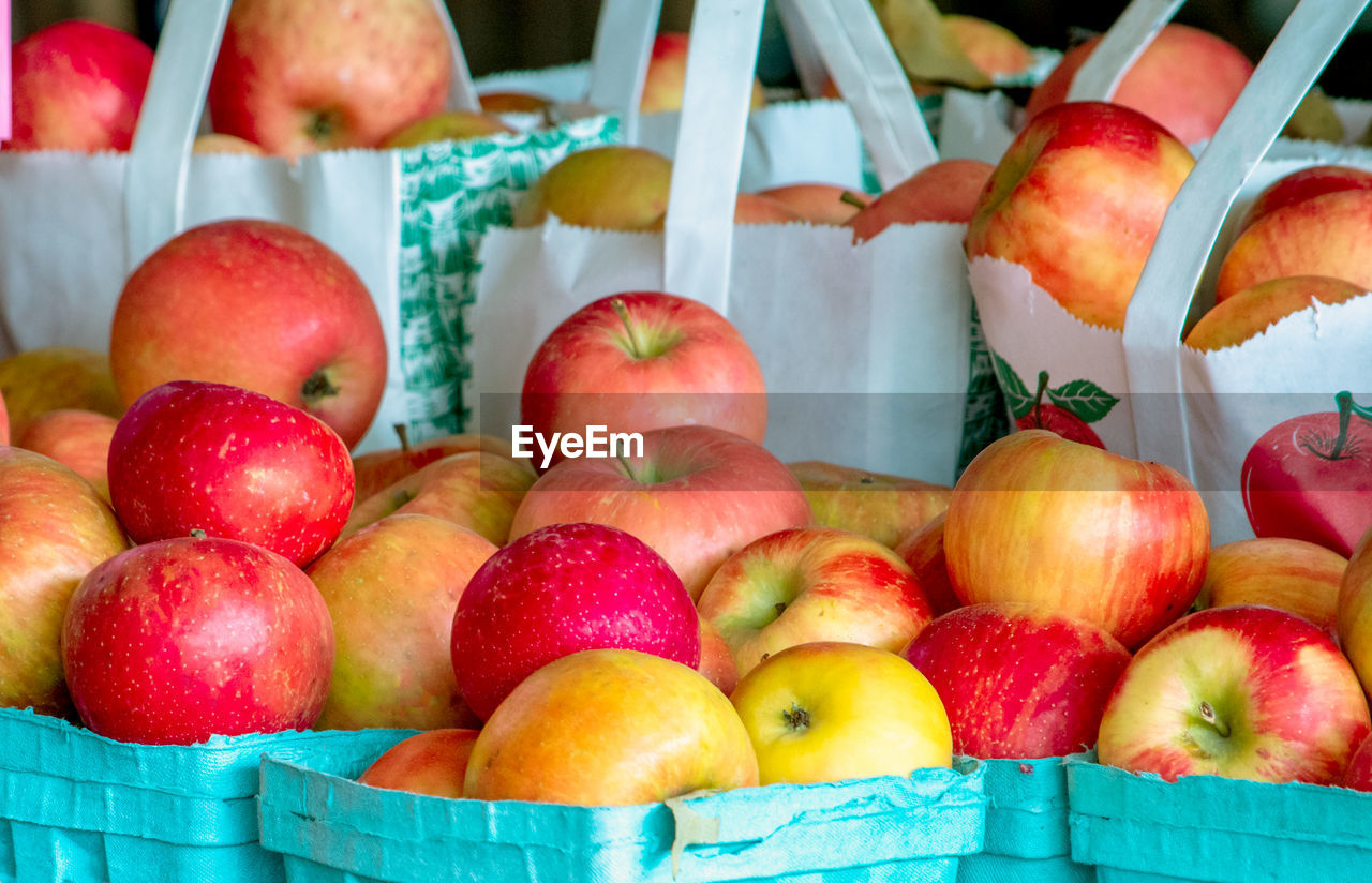 CLOSE-UP OF APPLES FOR SALE IN MARKET