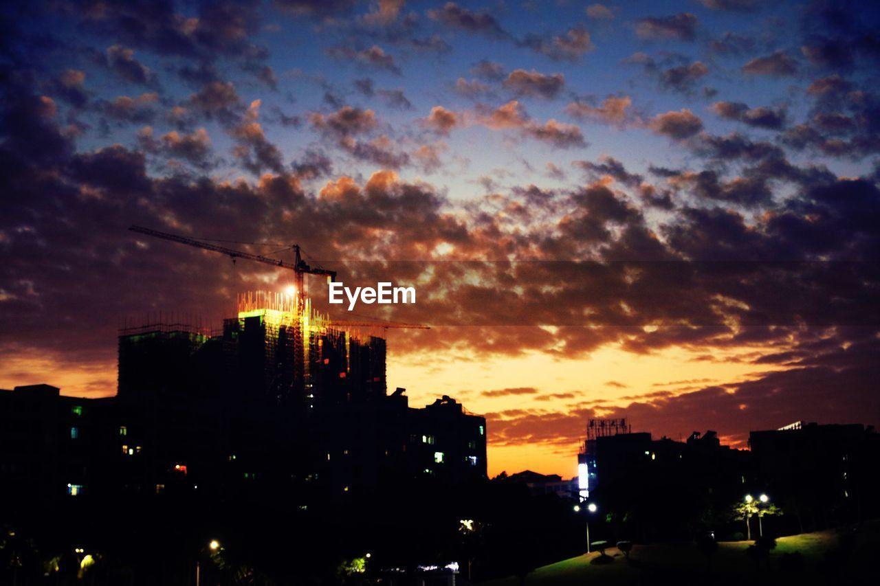 sunset, architecture, building exterior, built structure, sky, silhouette, city, orange color, cloud - sky, no people, cityscape, travel destinations, skyscraper, outdoors, illuminated, beauty in nature, nature, urban skyline