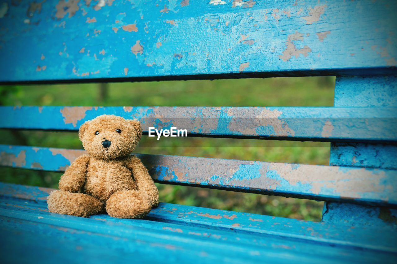 Close-Up Of Stuffed Toy On Bench