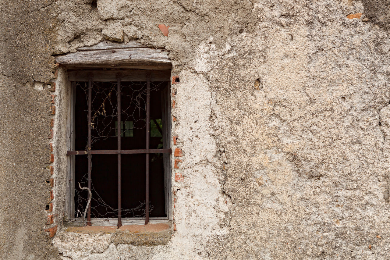 window, architecture, building exterior, built structure, building, wall - building feature, old, no people, house, damaged, day, outdoors, wall, backgrounds, residential district, abandoned, weathered, grid, full frame, stone material, window frame, stone wall, concrete