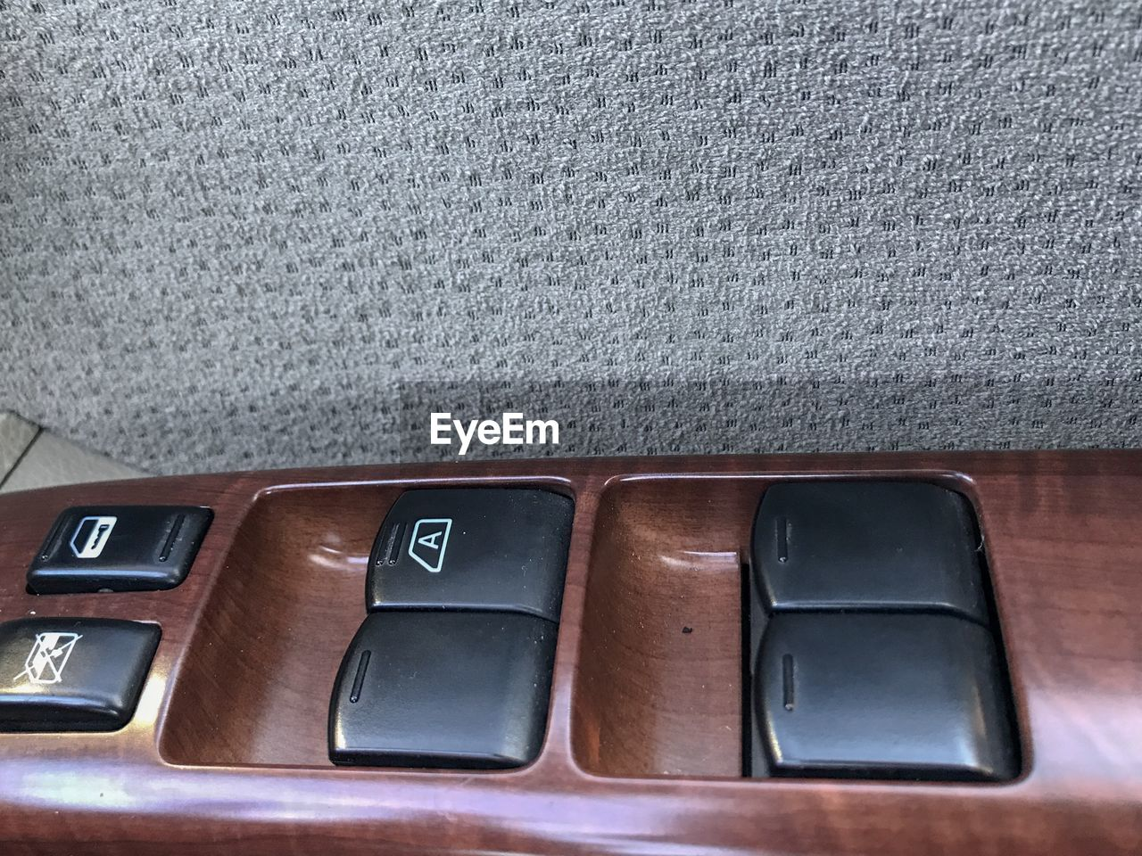 close-up, indoors, number, no people, text, communication, side by side, high angle view, technology, table, transportation, mode of transportation, wood - material, car, still life, western script, glass - material, push button, vehicle interior, connection, leather