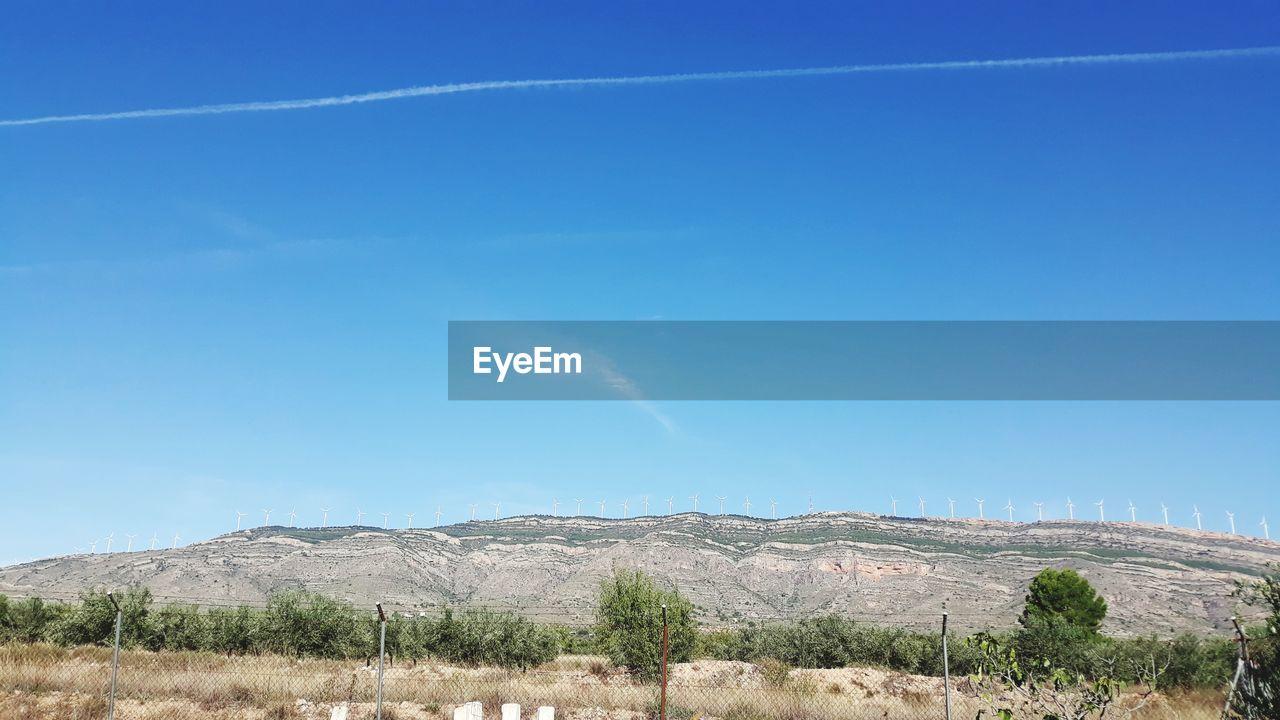 LANDSCAPE AGAINST BLUE SKY