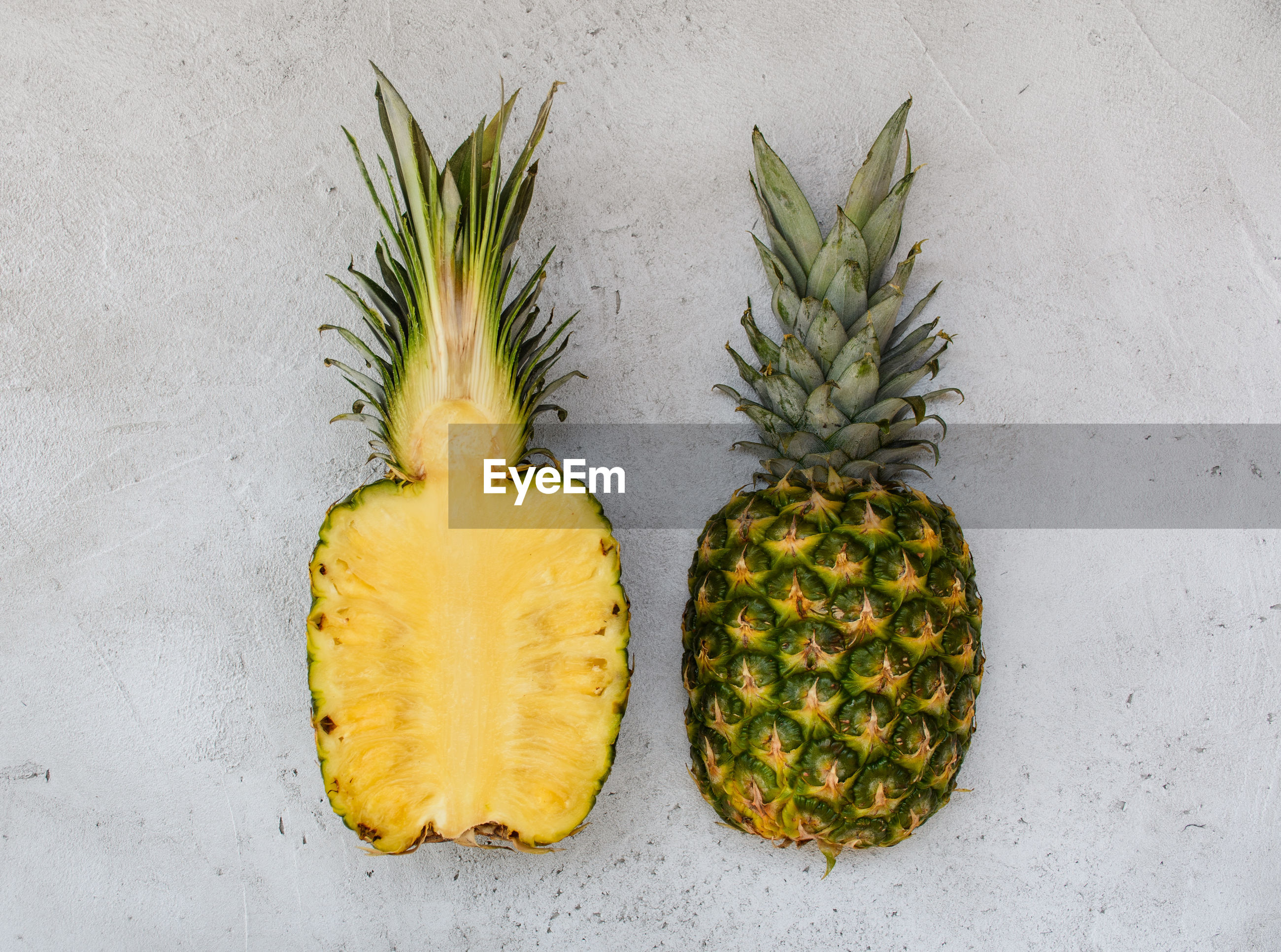 High angle view of fruits against white background, overhead, pineapple.