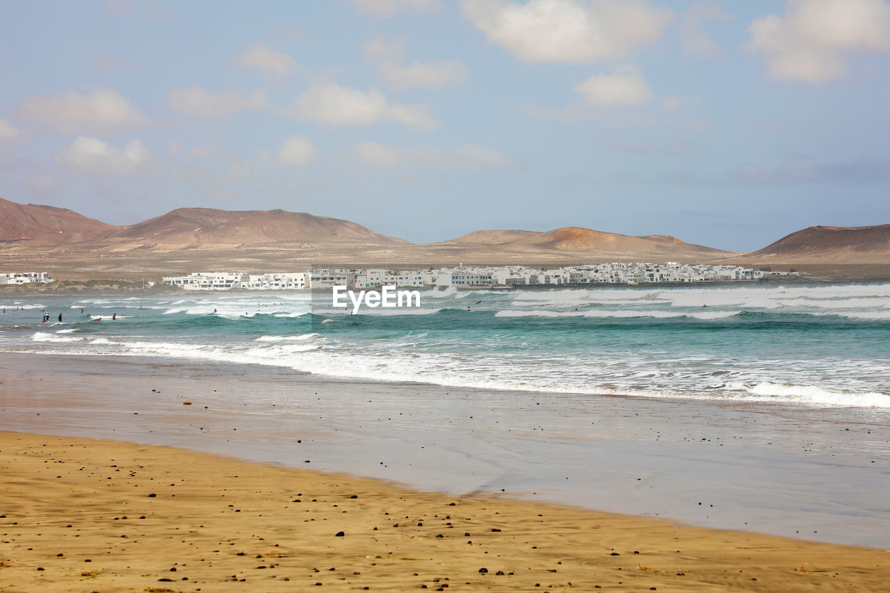 beach, land, water, sea, sand, beauty in nature, sky, scenics - nature, mountain, nature, motion, wave, tranquility, tranquil scene, sport, cloud - sky, day, no people, outdoors