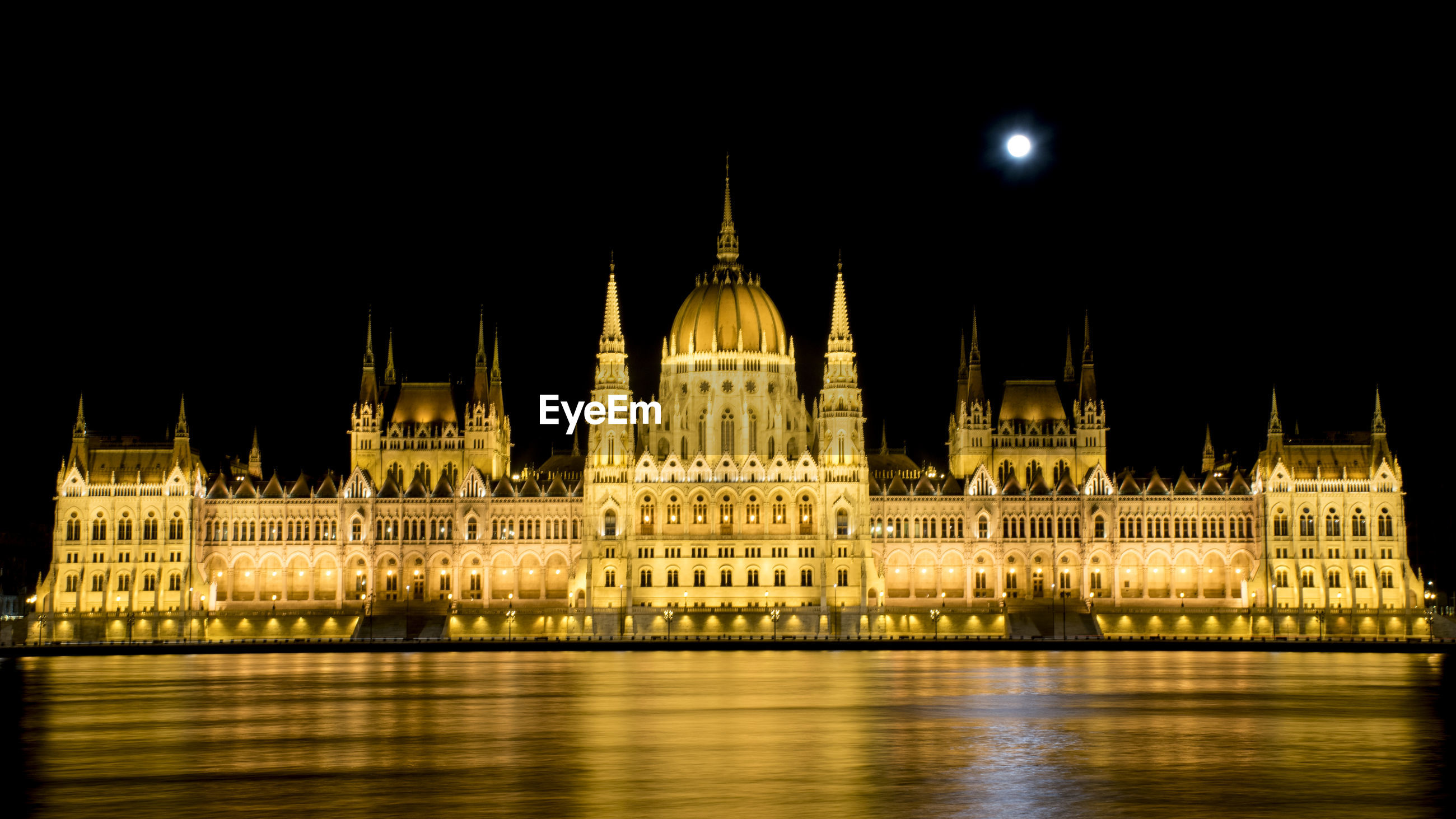 View of illuminated parliament building against clear sky at night
