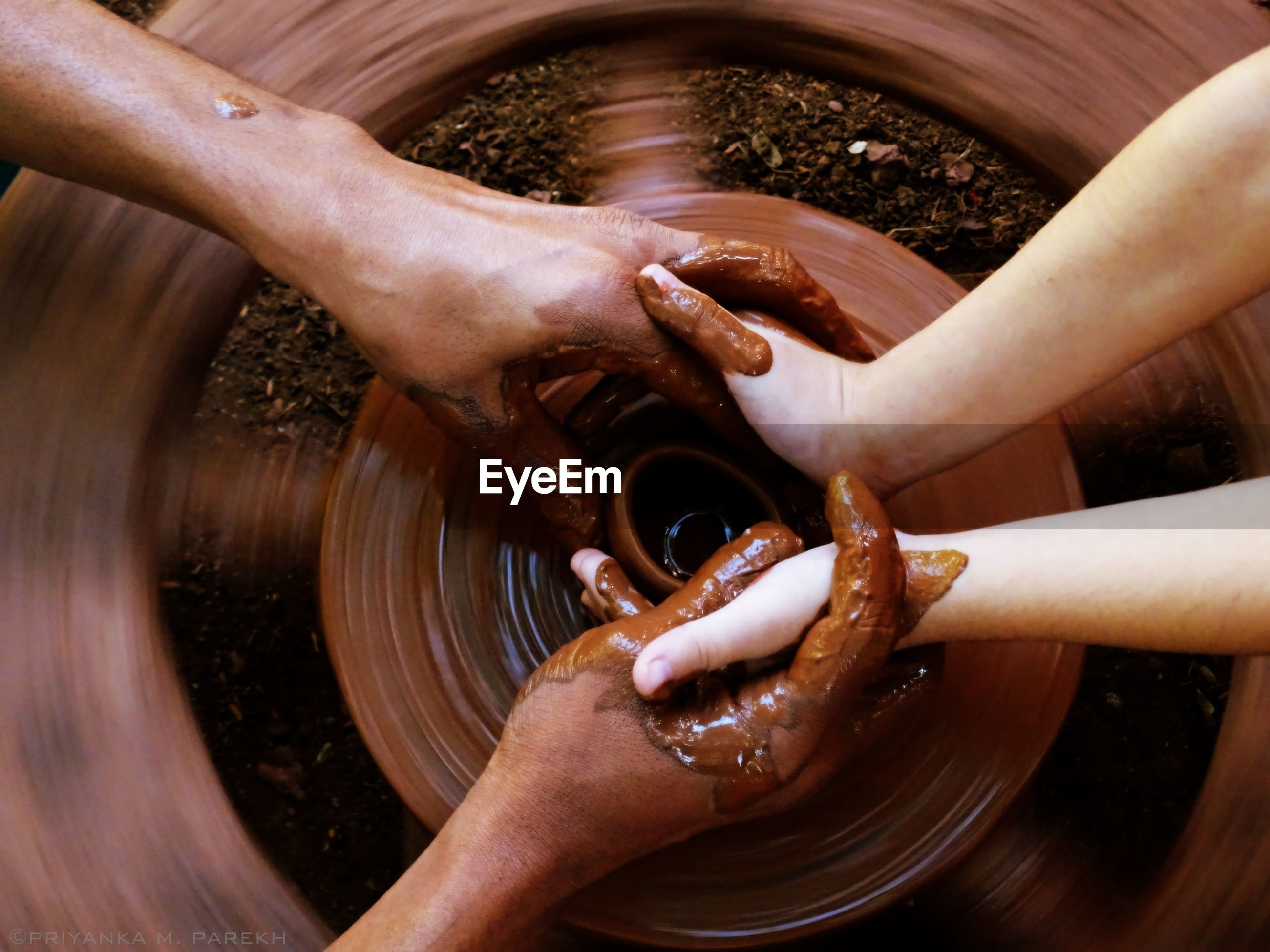 Cropped image of people making pottery