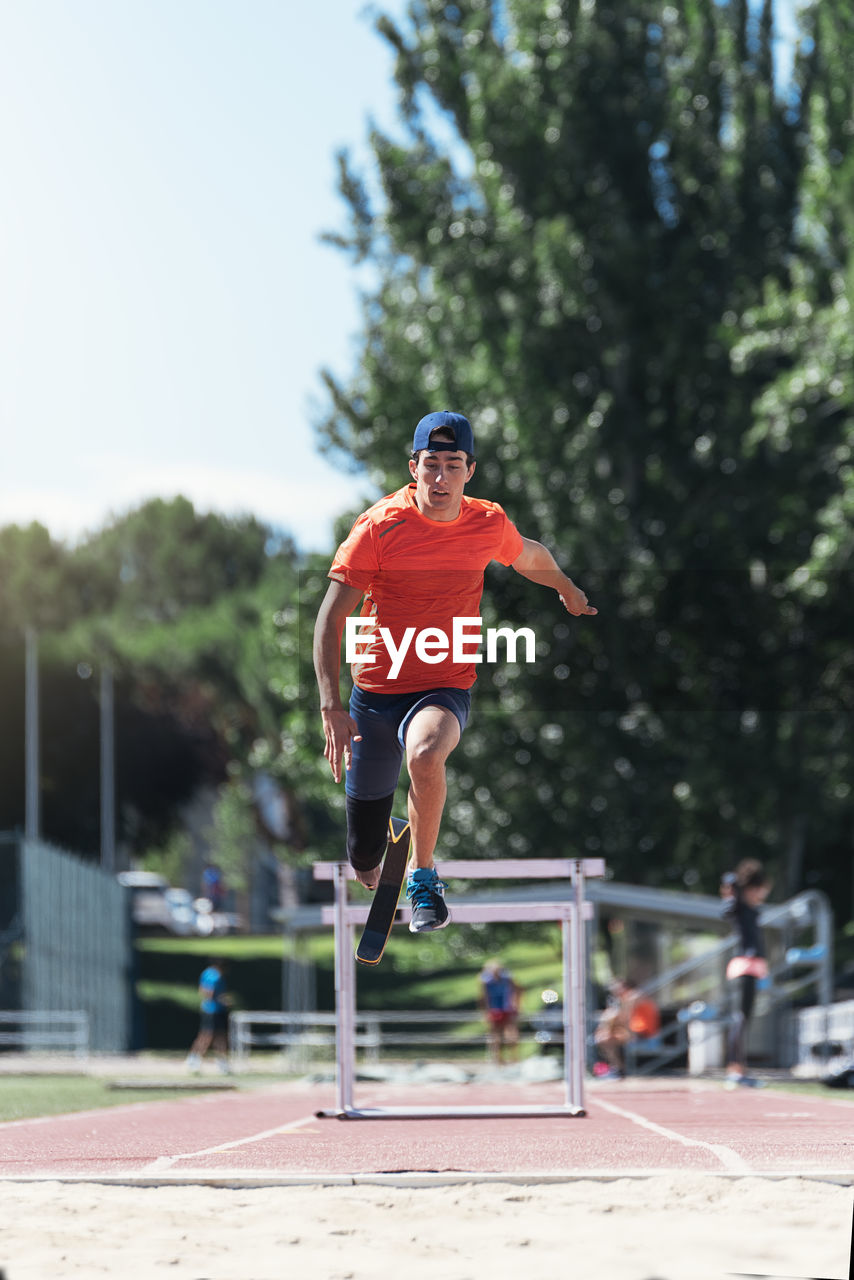 Man with prostethic leg jumping