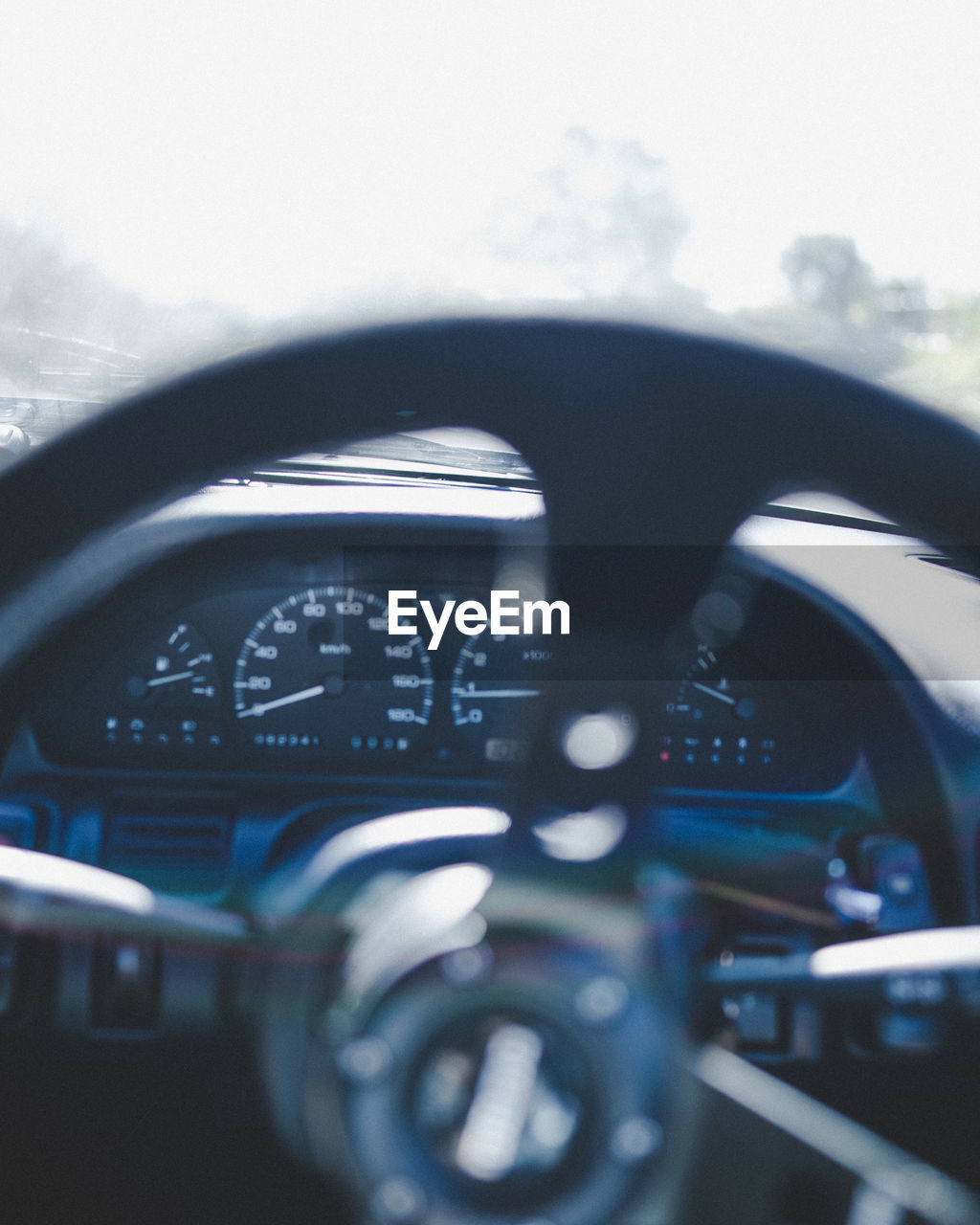 Close-up of steering wheel in car