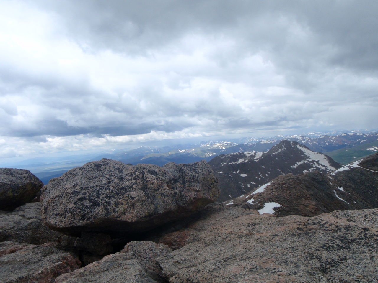 Scenic View Of Dramatic Landscape Against Cloudy Sky