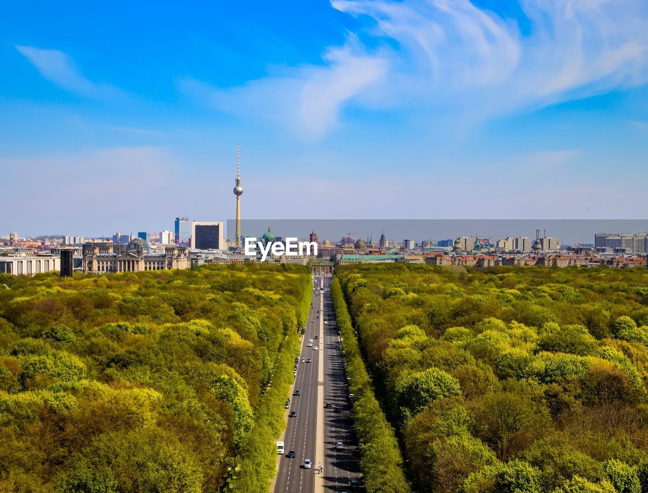 architecture, built structure, sky, building exterior, city, cloud - sky, plant, transportation, nature, tree, road, tower, no people, travel, tall - high, building, green color, travel destinations, day, cityscape, outdoors, office building exterior, skyscraper, spire