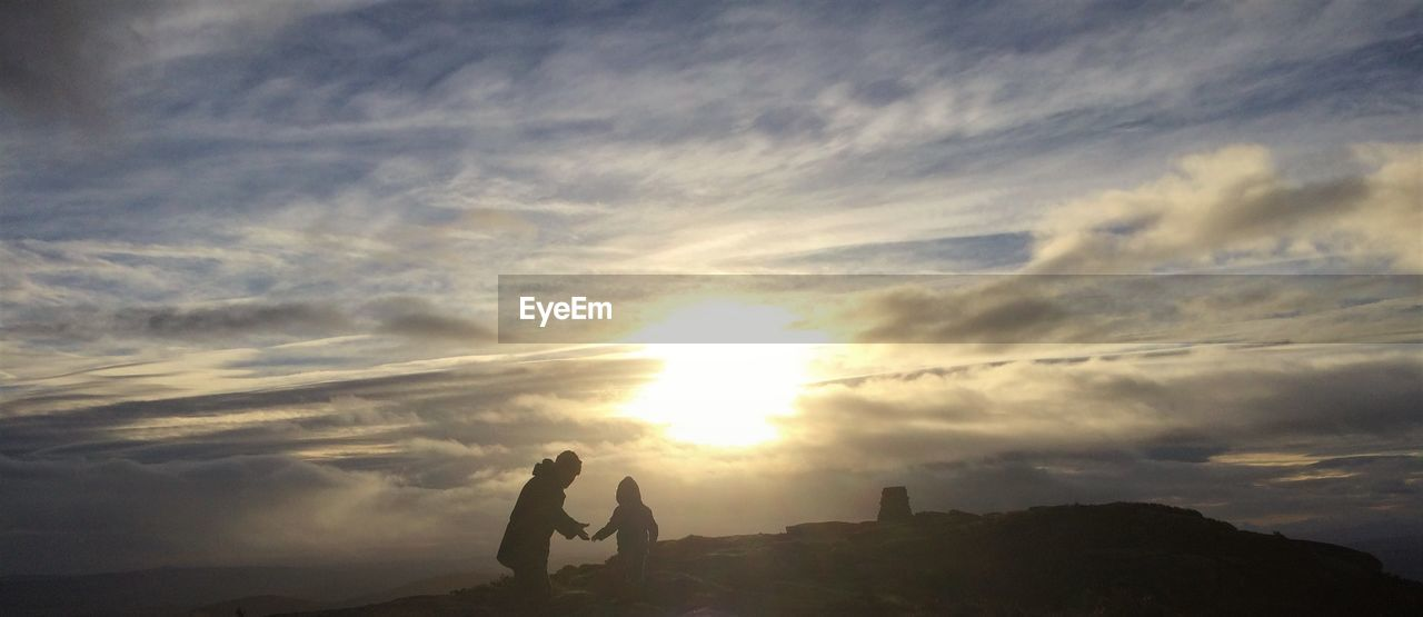 sunset, sky, cloud - sky, two people, silhouette, real people, togetherness, nature, men, leisure activity, love, beauty in nature, scenics, lifestyles, outdoors, bonding, women, friendship, day, people