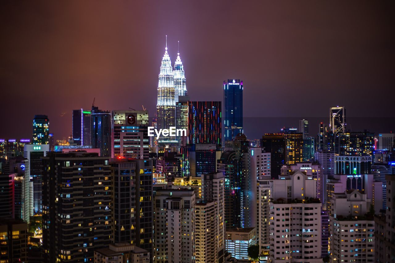 building exterior, architecture, built structure, city, building, office building exterior, tall - high, cityscape, skyscraper, illuminated, sky, night, modern, tower, urban skyline, office, nature, residential district, crowded, financial district, outdoors, spire, nightlife