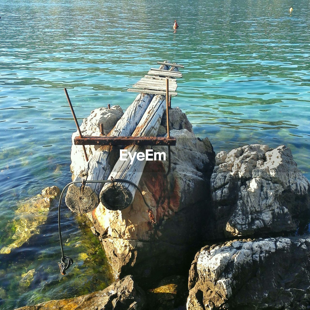 water, day, high angle view, rock - object, nature, no people, wood - material, outdoors, sunlight, lake, beauty in nature, nautical vessel