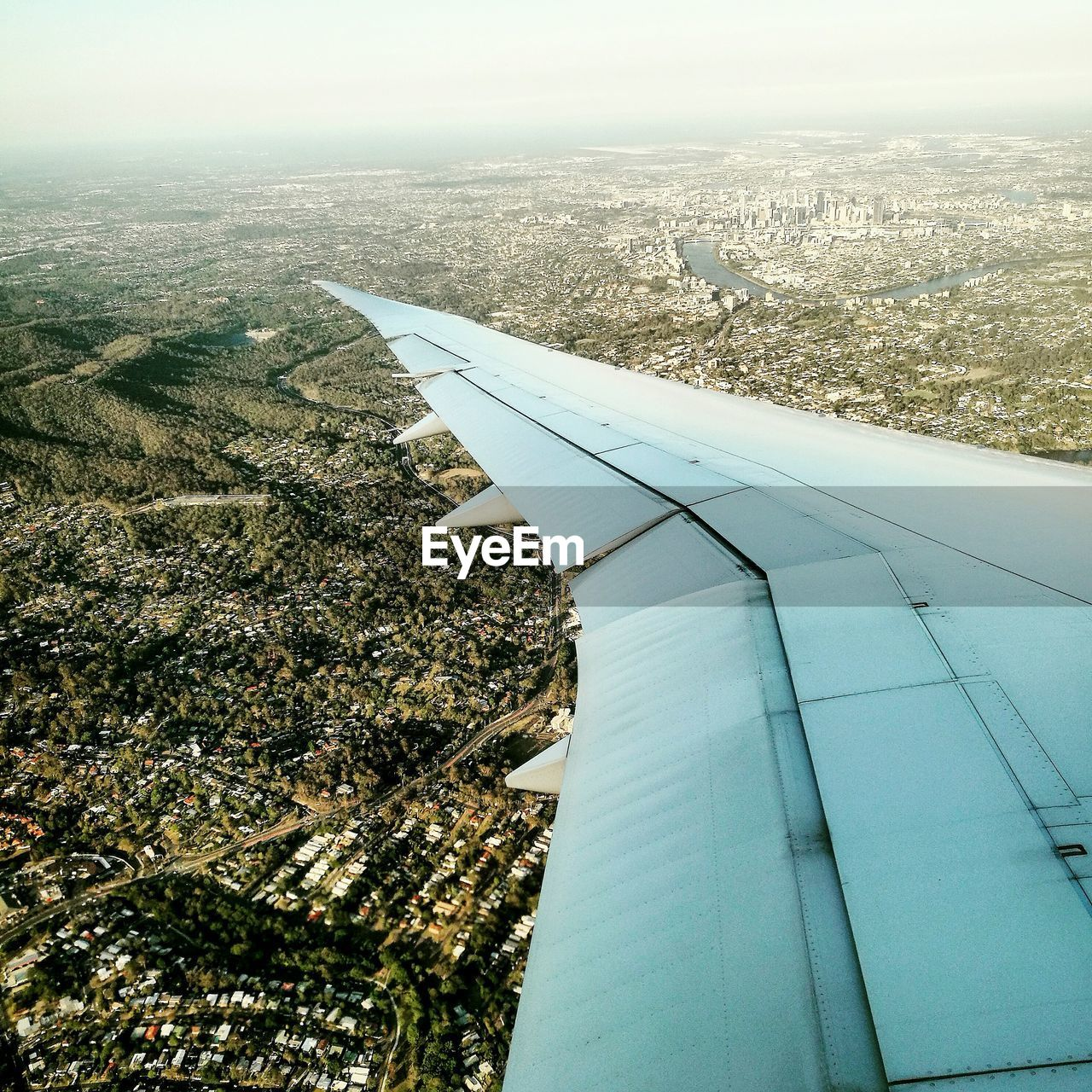 airplane, aerial view, travel, day, transportation, journey, nature, flying, aircraft wing, no people, air vehicle, outdoors, landscape, sky, airplane wing, built structure, travel destinations, scenics, cityscape, building exterior, beauty in nature, architecture, city