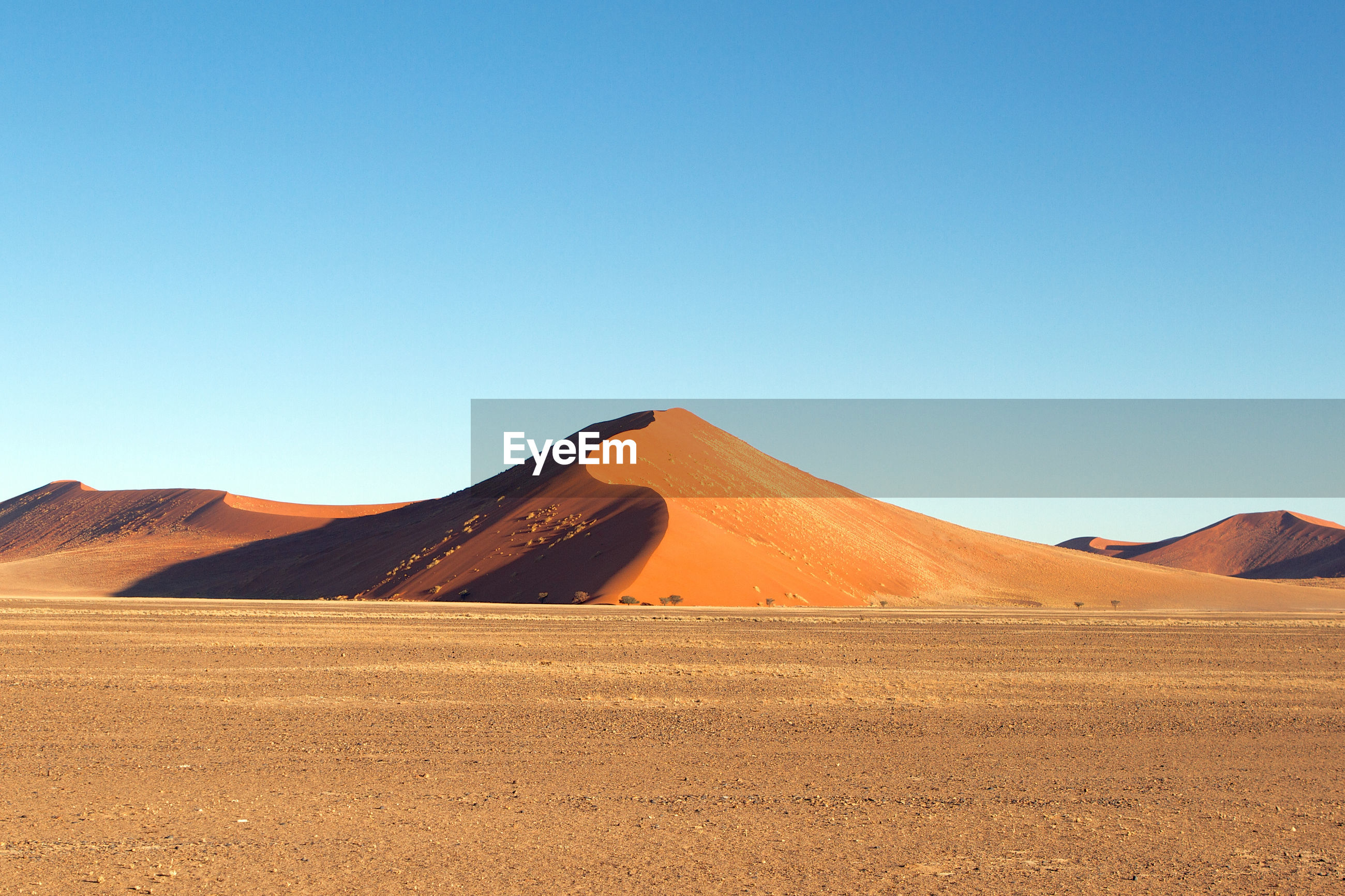 SCENIC VIEW OF DESERT LAND AGAINST CLEAR SKY