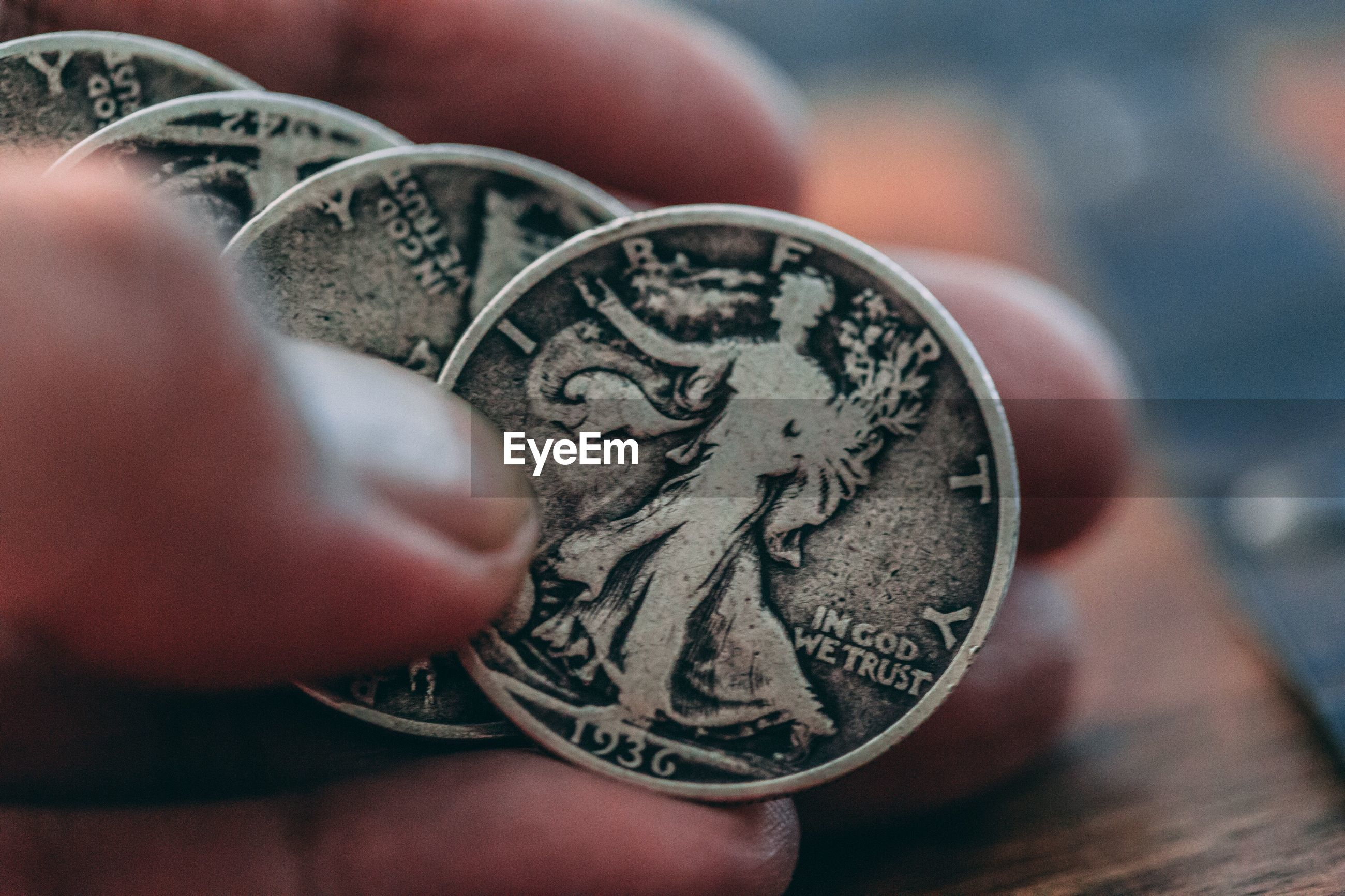 Cropped image of hand holding coins