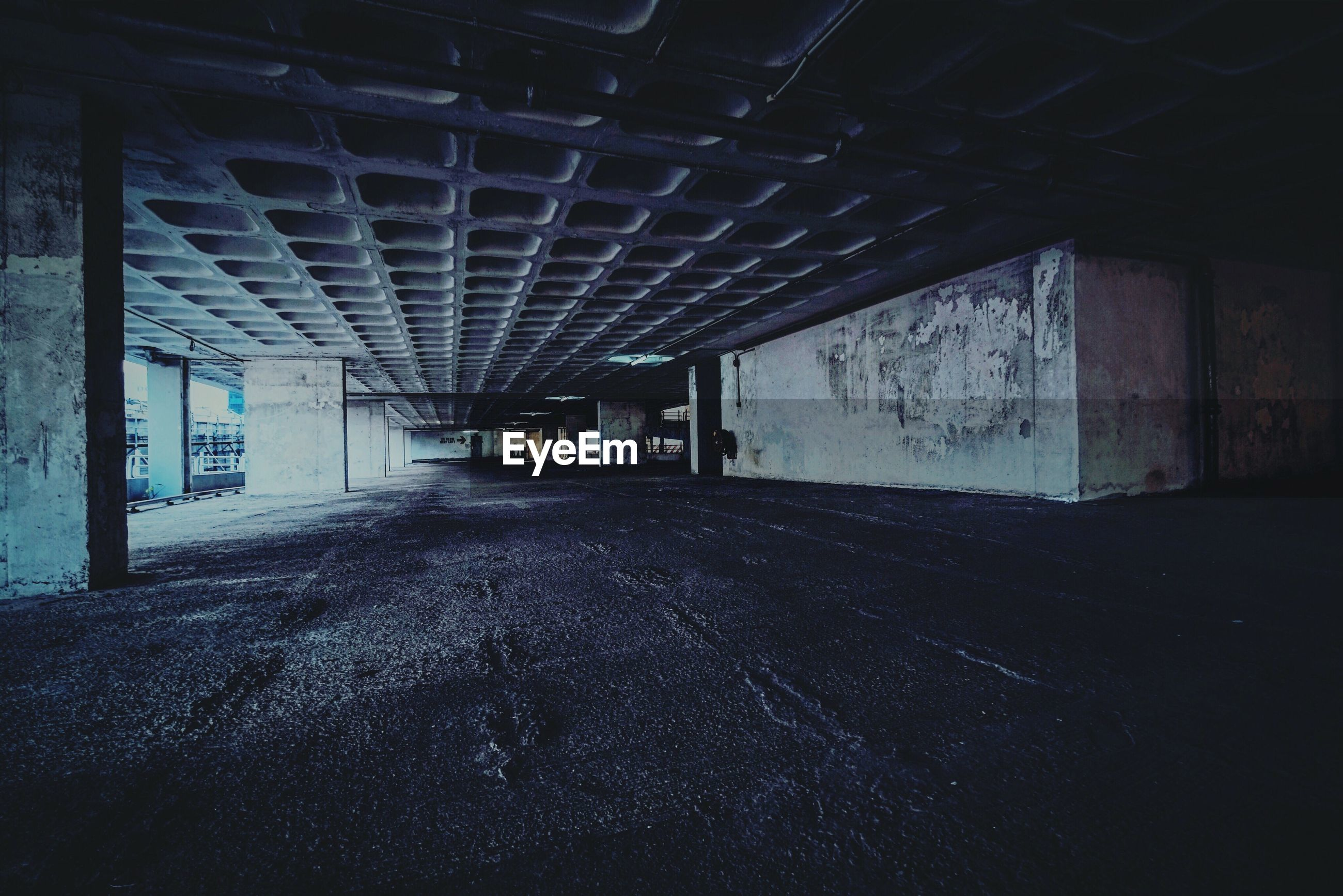 indoors, architecture, built structure, abandoned, ceiling, wall - building feature, empty, the way forward, tunnel, window, interior, obsolete, illuminated, absence, wall, building, damaged, no people, dark, run-down