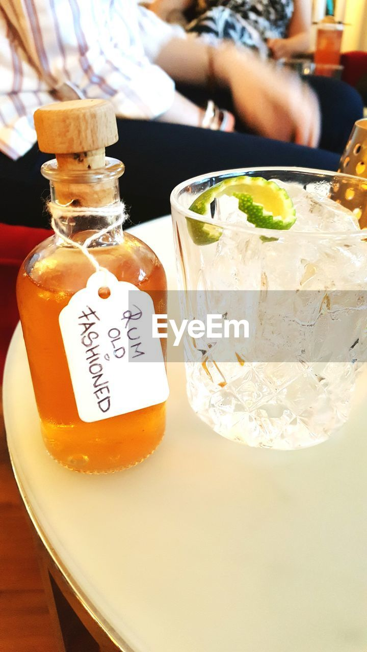 Close-up Of Rum And Cocktail On Table