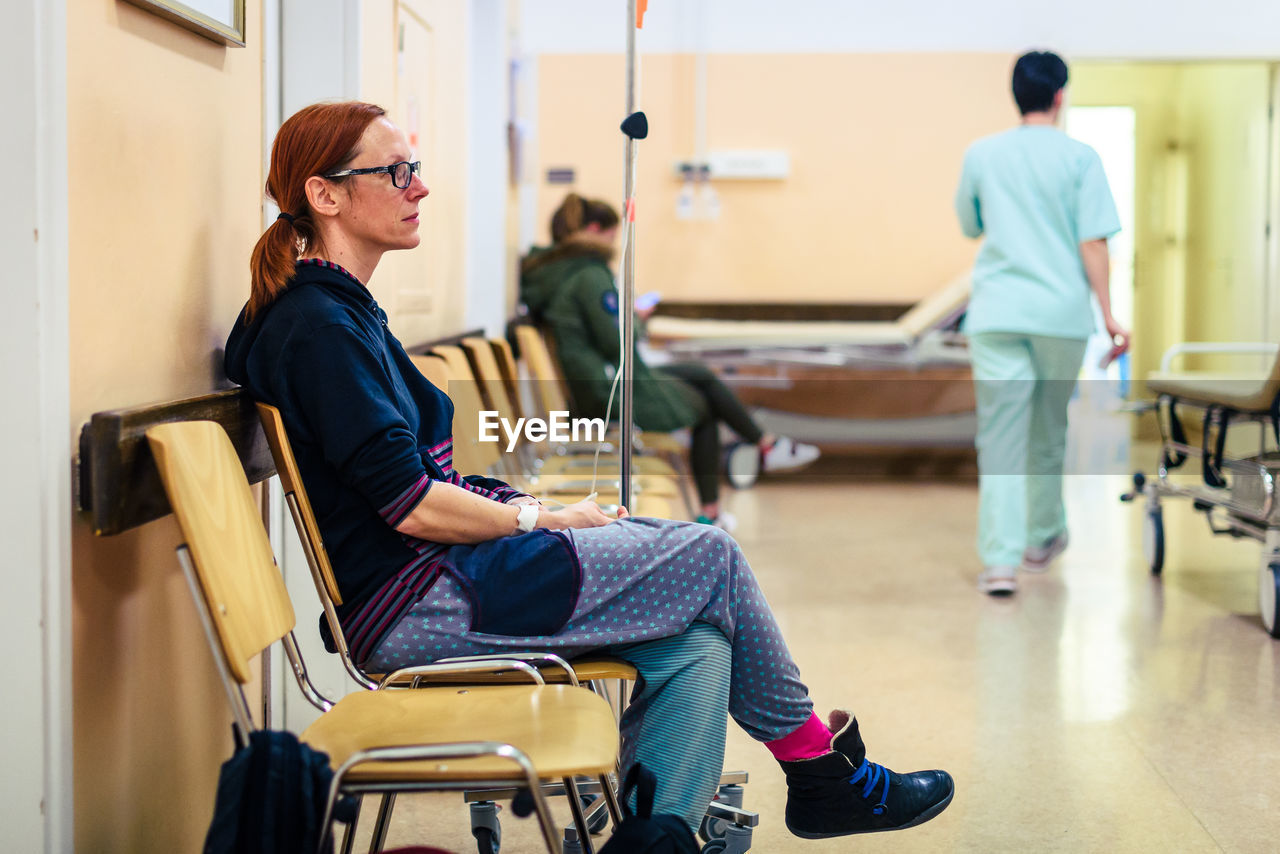 Woman Sitting In Hospital Waiting Room