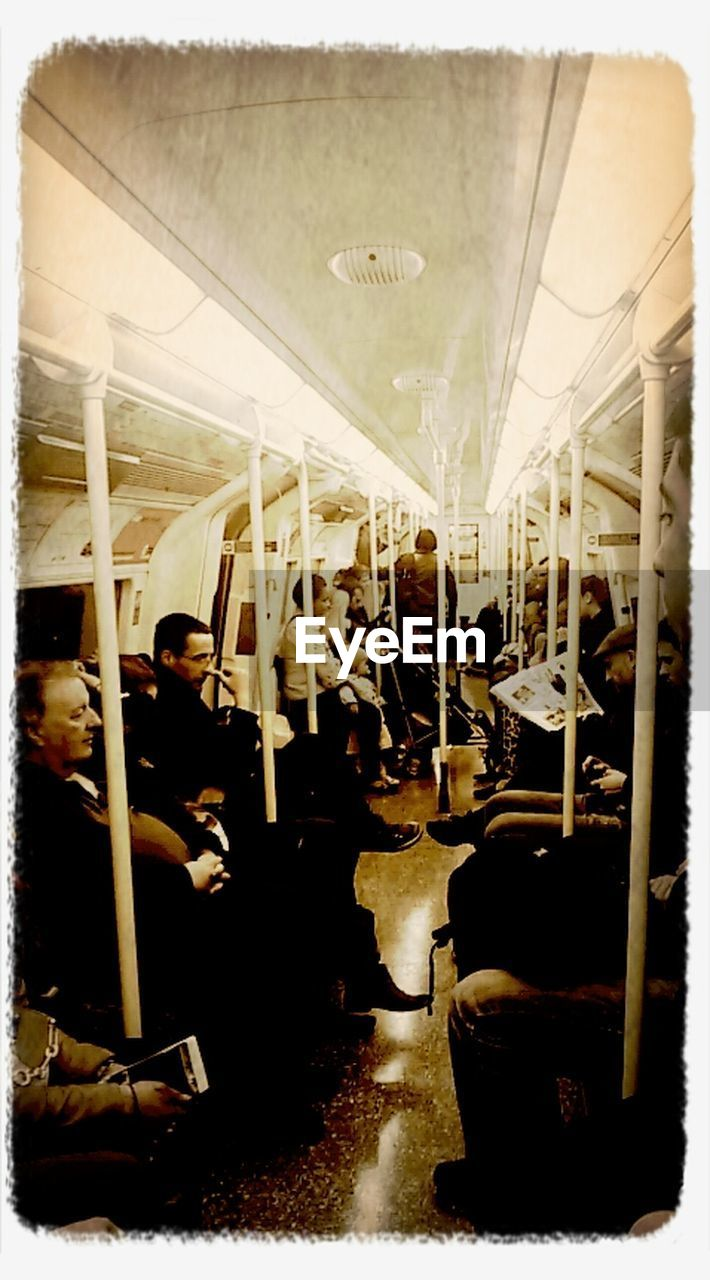 vehicle seat, real people, public transportation, arts culture and entertainment, men, indoors, day, people