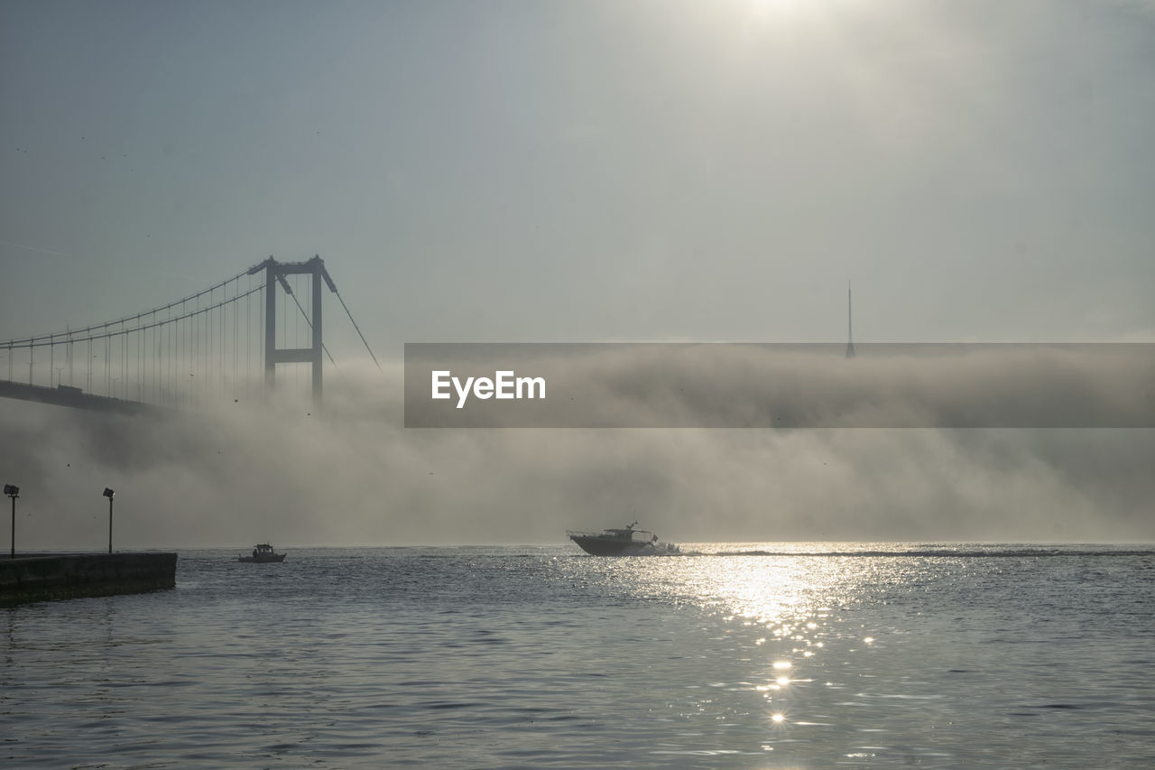 Speed boat and 15 july martyrs in foggy morning istanbul turkey