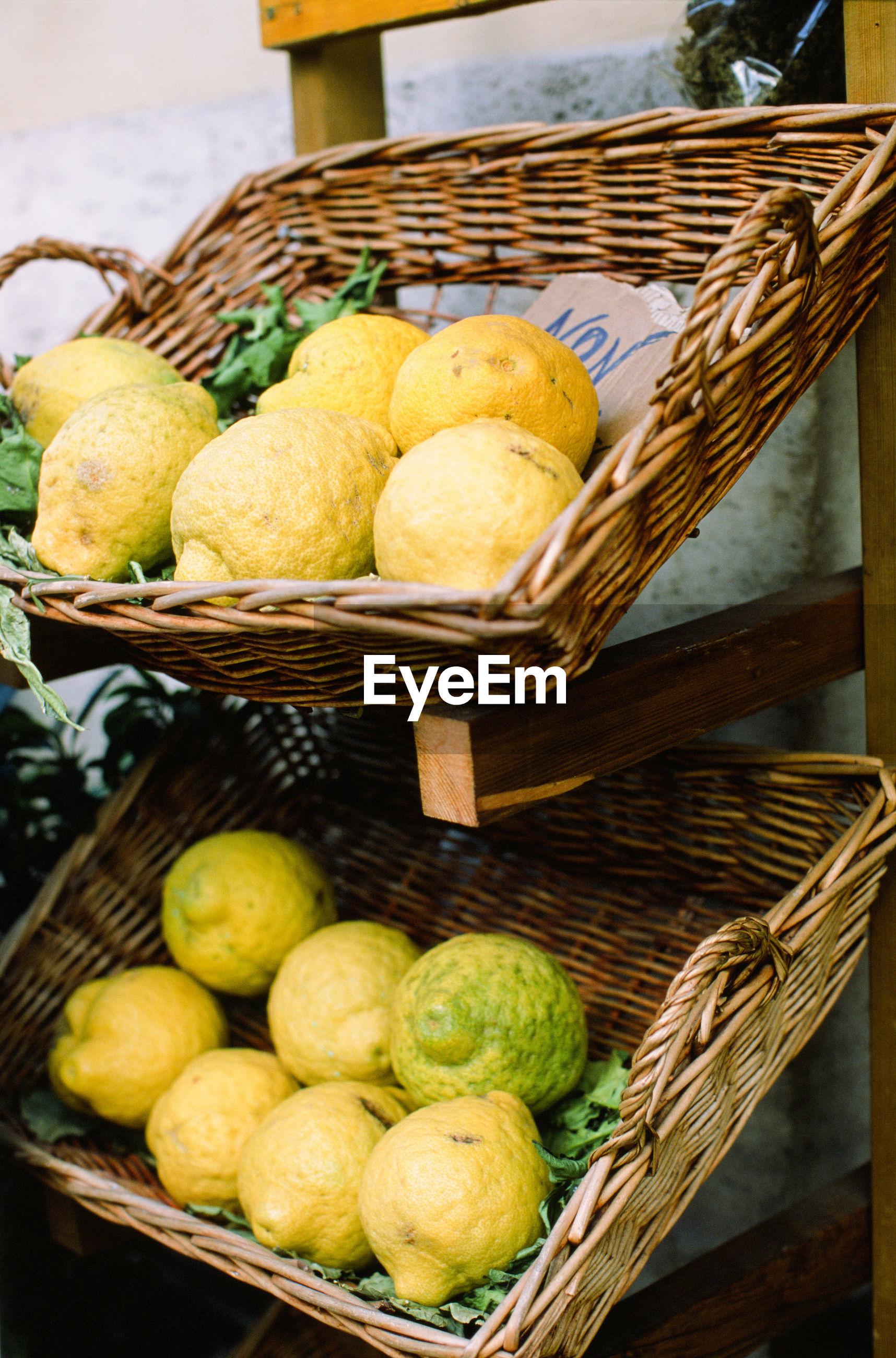 Lemon in basket for sale at market stall