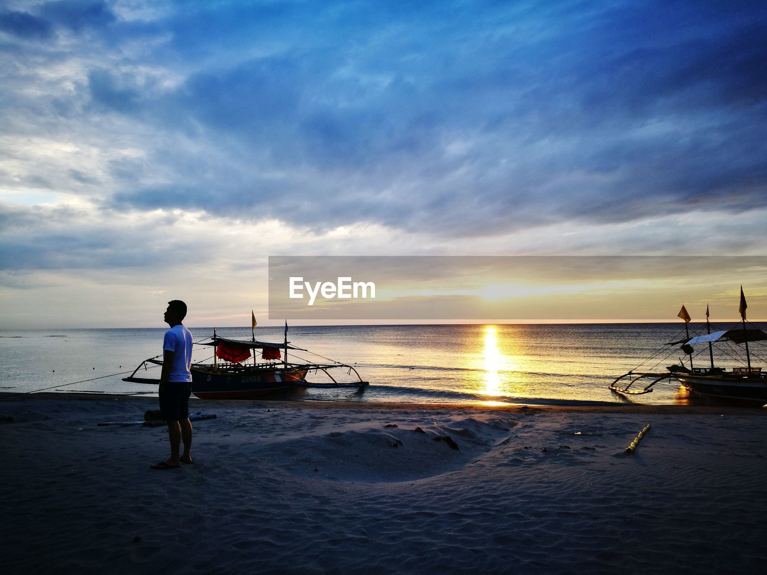 fishing, sunset, sea, water, occupation, sky, beauty in nature, fishing net, nautical vessel, fisherman, cloud - sky, nature, outdoors, tranquility, tranquil scene, men, only men, scenics, people, adult, beach, outdoor pursuit, one person, adults only, one man only, day
