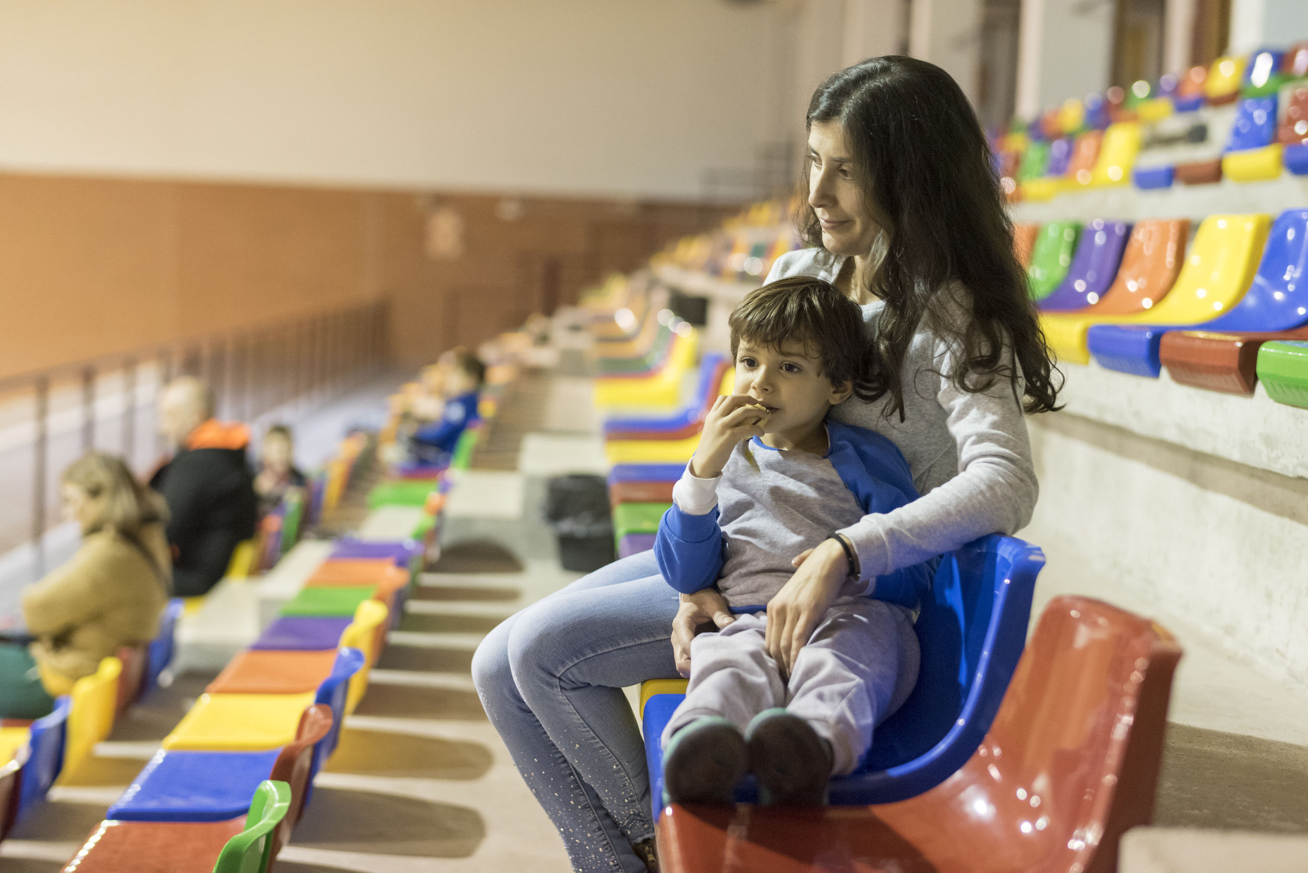Mother sitting with son on seat