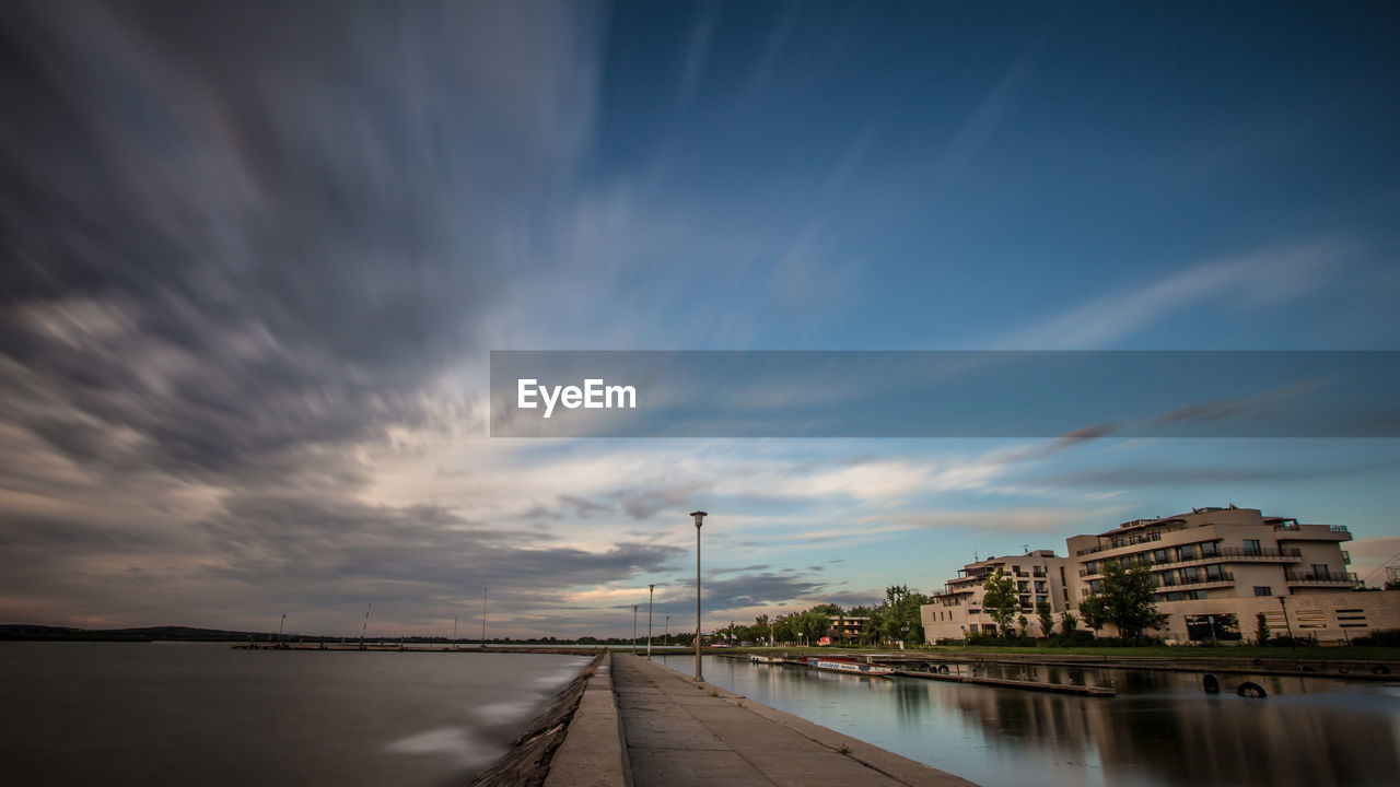 cloud - sky, architecture, sky, built structure, water, building exterior, outdoors, nature, no people, travel destinations, day, beauty in nature, city
