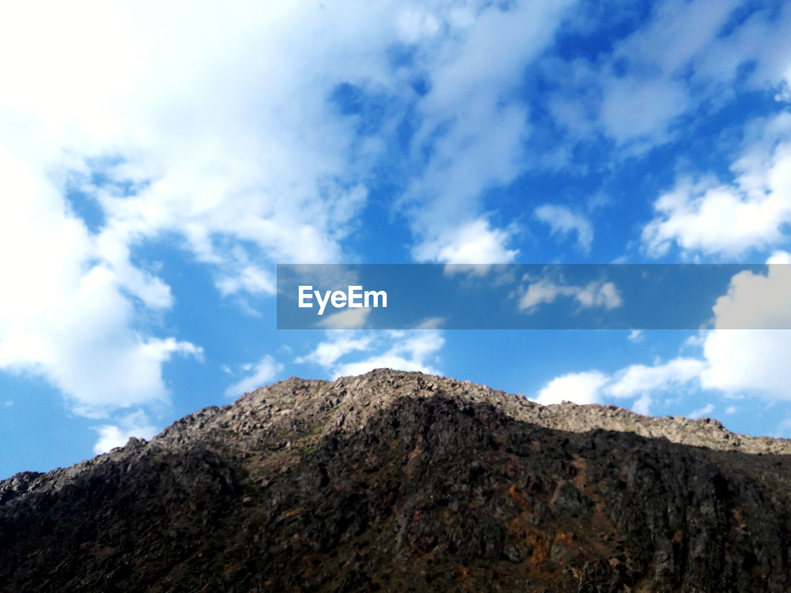 sky, low angle view, cloud - sky, mountain, day, nature, outdoors, no people, beauty in nature, scenics