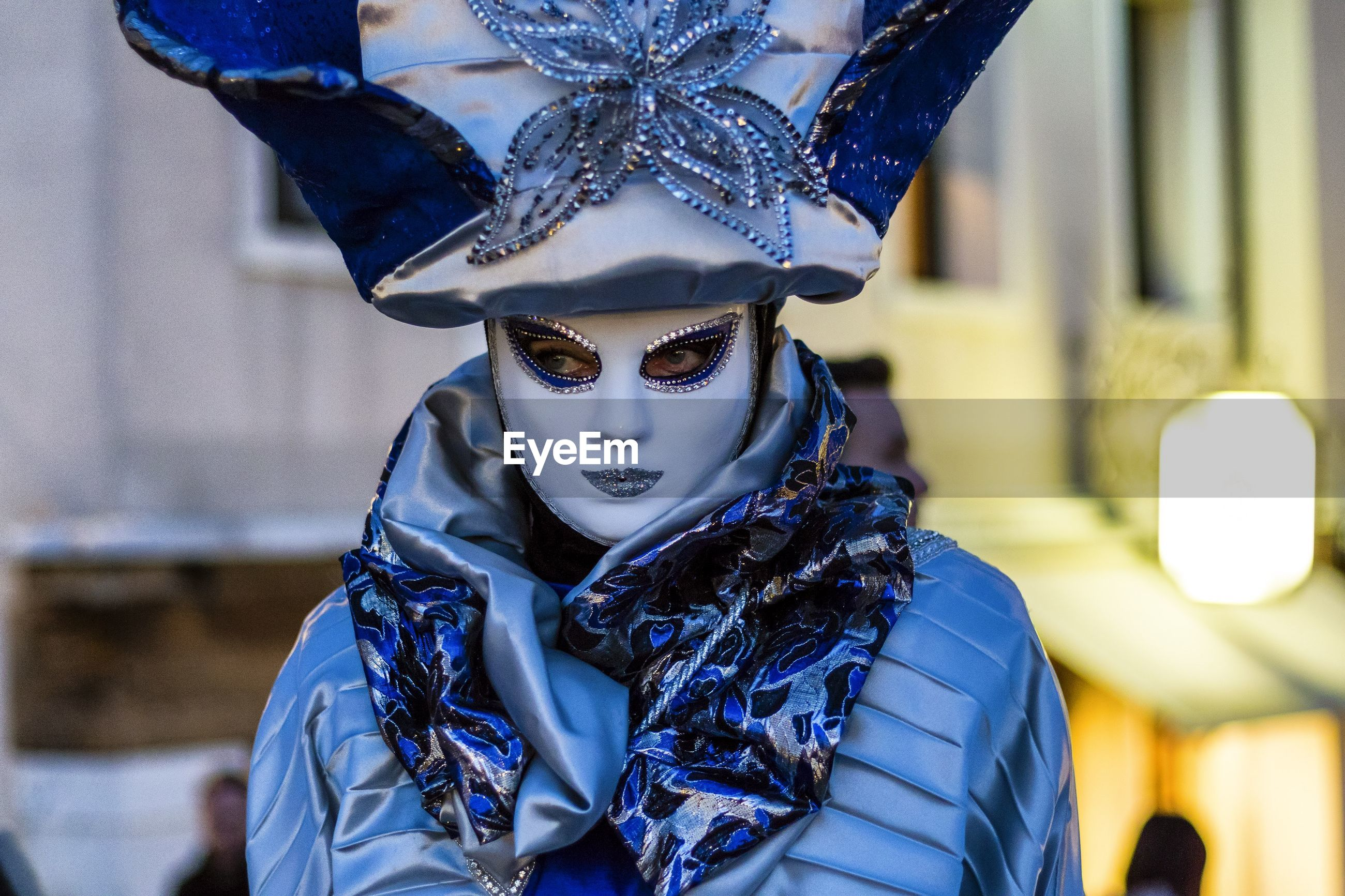 Close-up of person wearing venetian mask