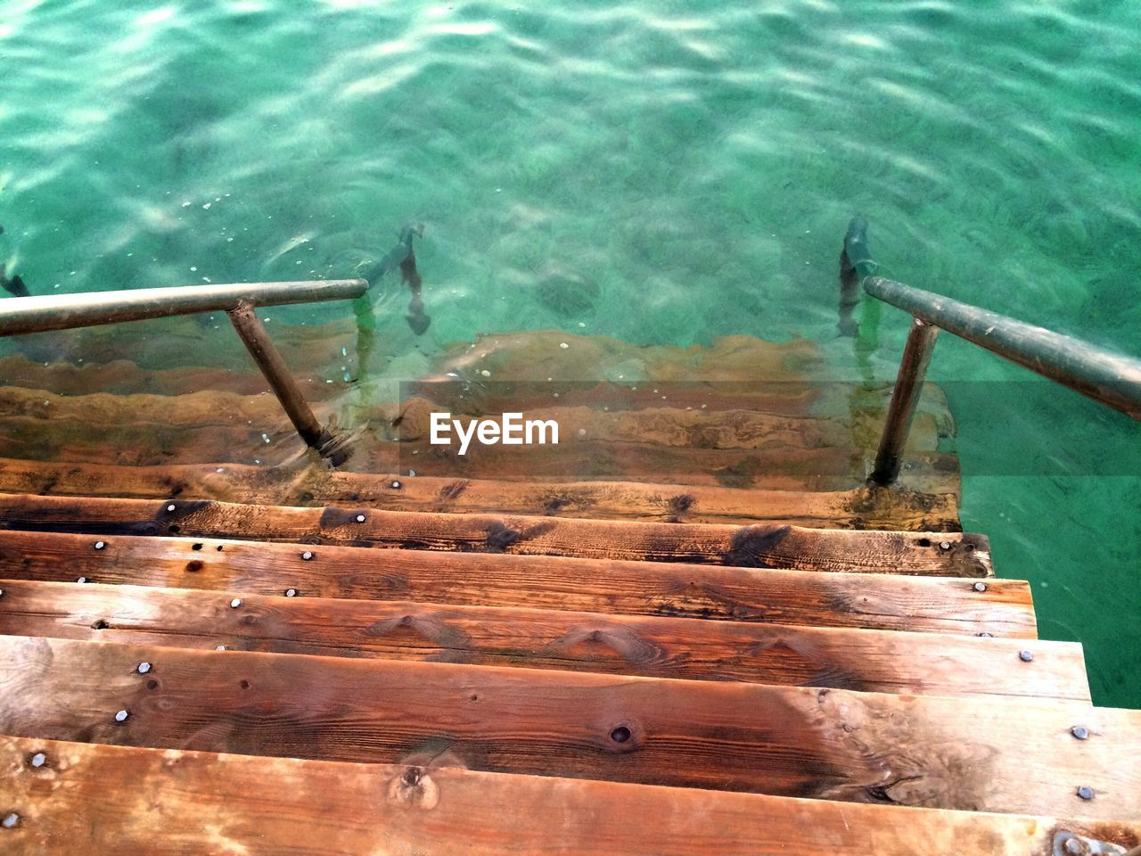 High angle view of steps in water