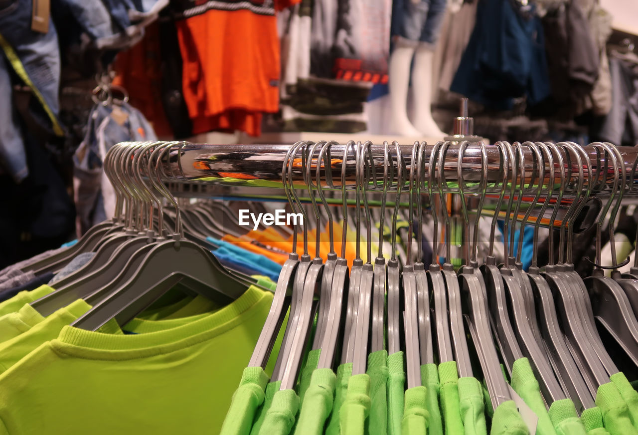 Close-up of clothing rack in store